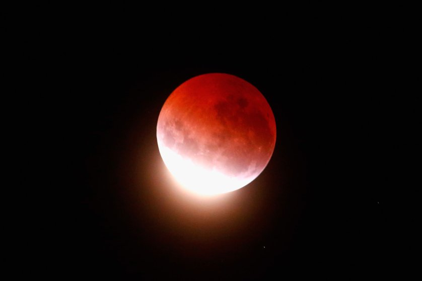 The blood moon lights up the sky during a total lunar eclipse on April 4, 2015 in Auckland.
