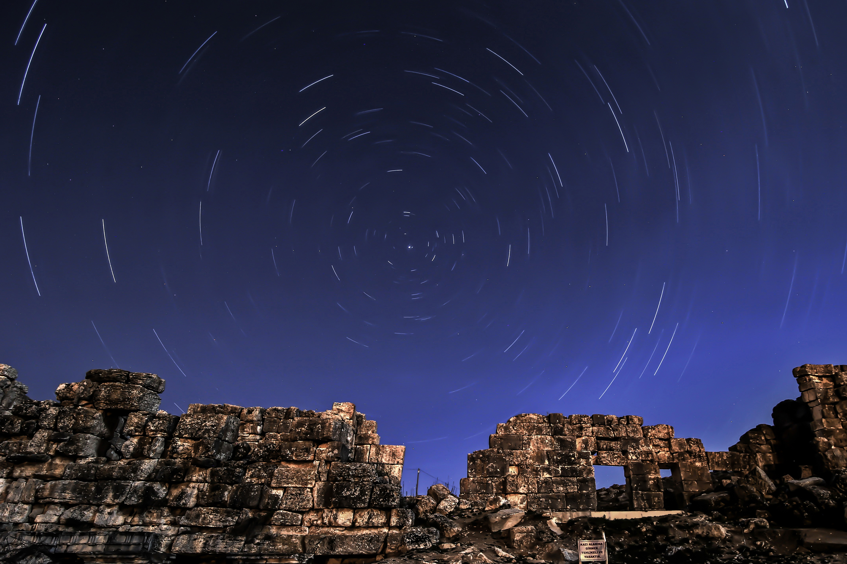 The April Lyrids, a meteor shower lasting from April 16 to April 26 each year, is seen over the ancient city of Aizanoi in Kutahya, Turkey on April 23, 2014.