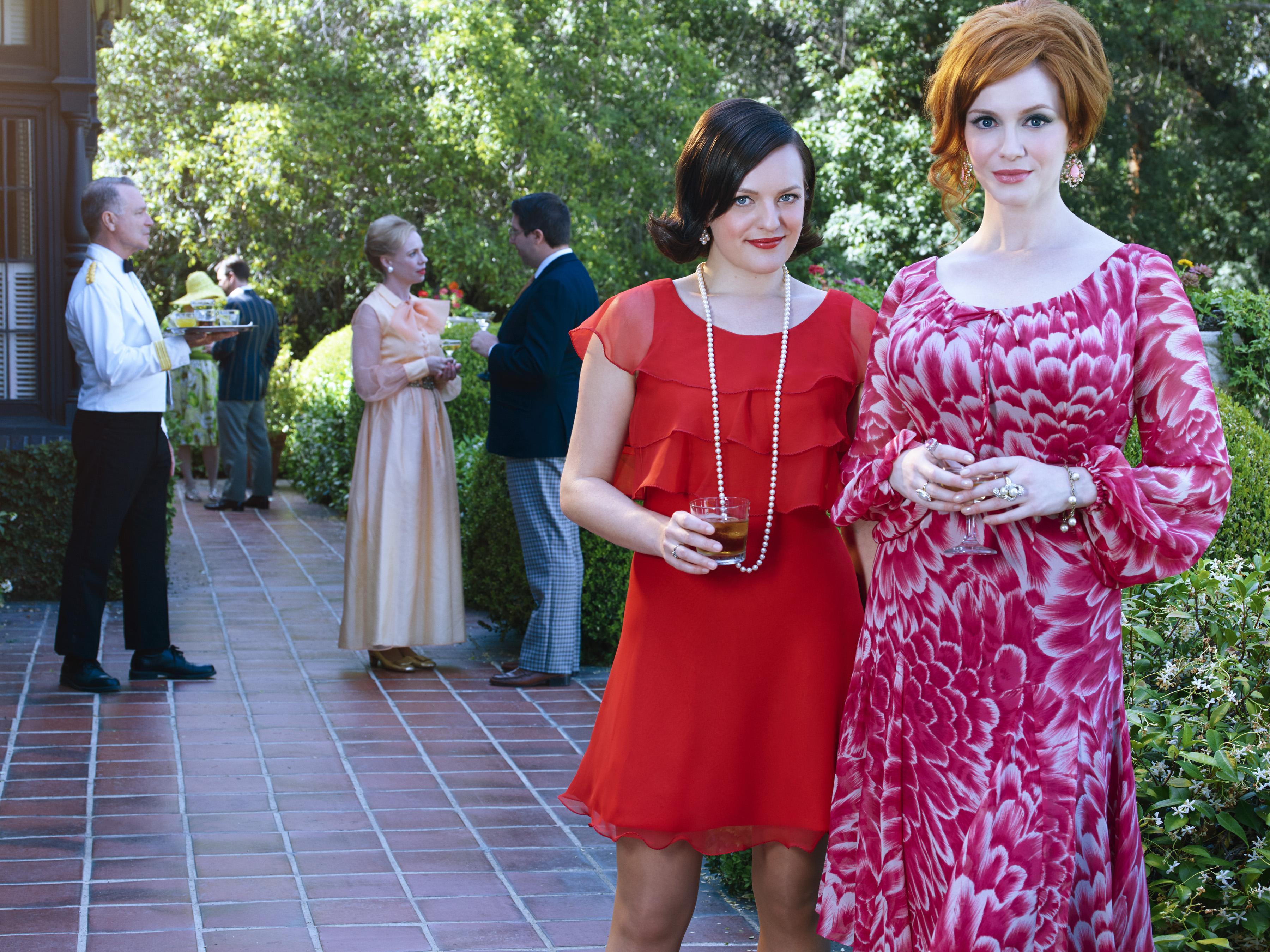 Elisabeth Moss as Peggy Olson and Christina Hendricks as Joan Harris in Mad Men.