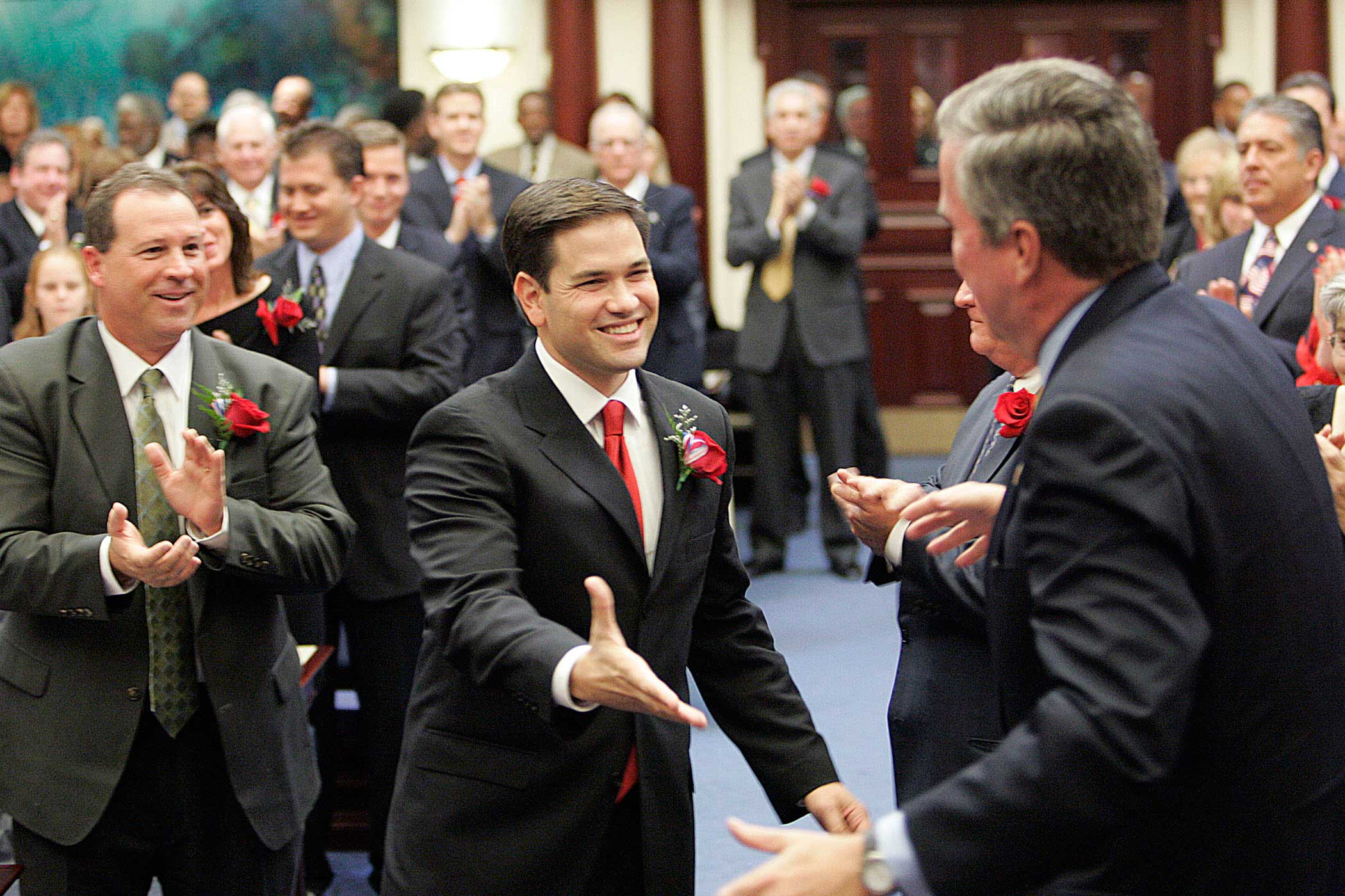 Marco Rubio greets Florida Gov. Jeb Bush, on his way to being sworn in as the new speaker of the Florida House in Tallahassee, Fla., on Nov. 21, 2006.