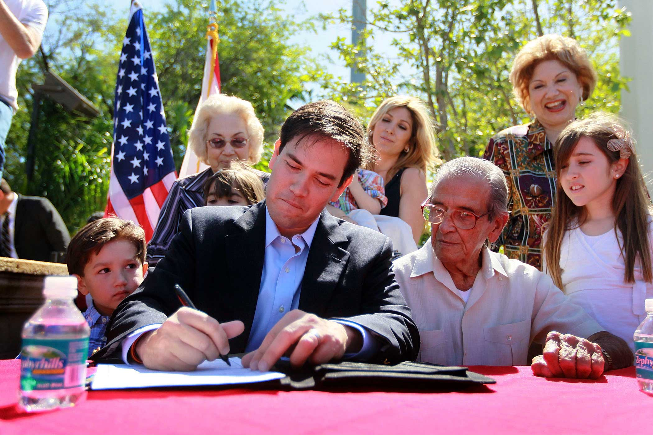 Marco Rubio with his son, Anthony Rubio, father, Mario Rubio and daughter Amanda Rubio as he signs election documents officially qualifying him as a Republican candidate for the U.S. Senate in Miami, Fla., on April 27, 2010.