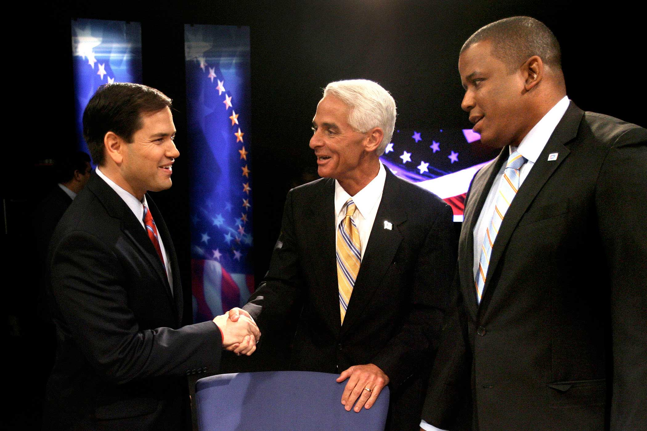 From left, Marco Rubio, Charlie Crist and Kendrick Meek greet each other before the start of their debate at the studios of WESH-TV in Winter Park, Fla., on Oct. 26, 2010.
