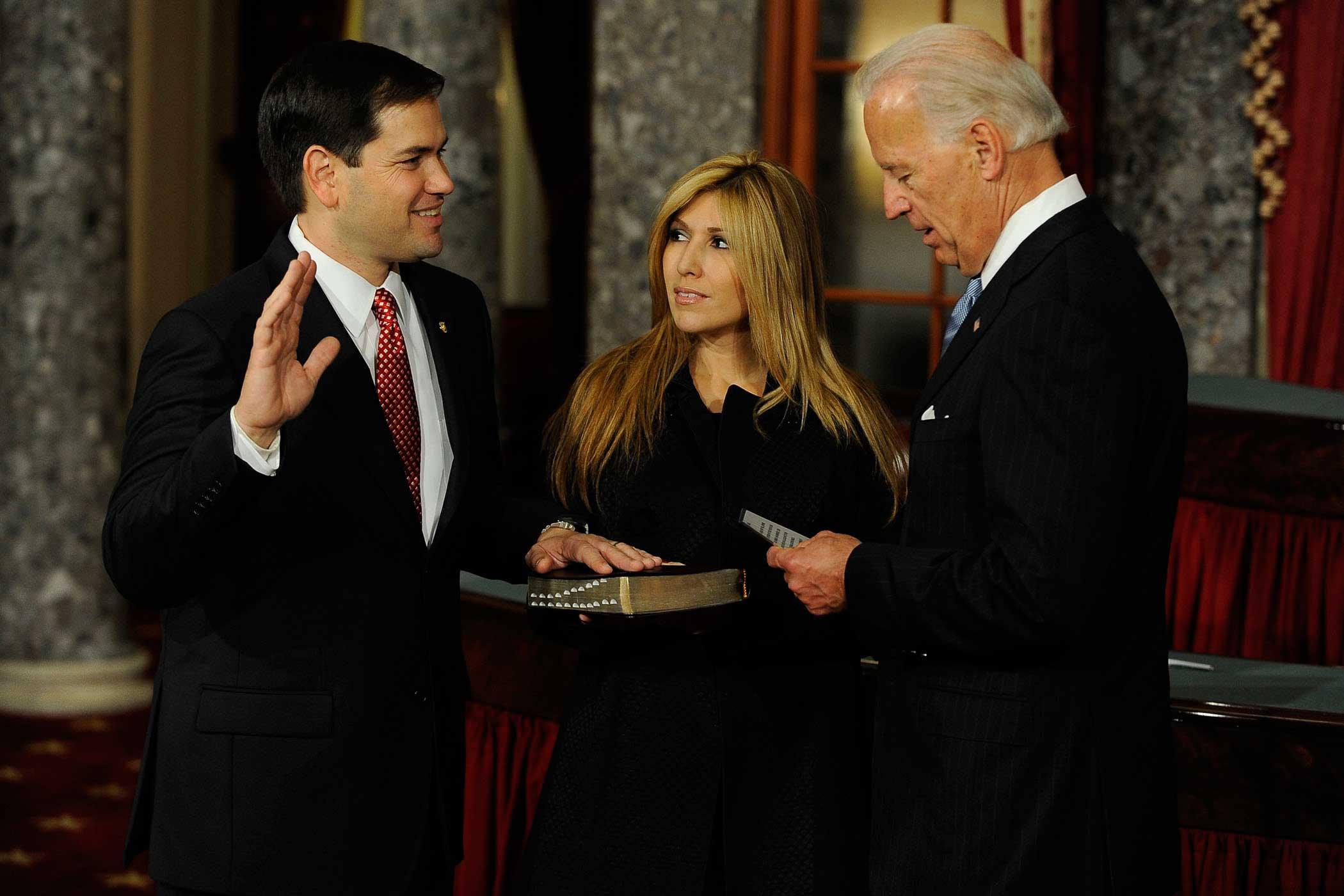 Vice President Joe Biden swears in Senator Marco Rubio to the U.S. Senate, as his wife, Jeanette Rubio looks on, in Washington, on Jan. 5, 2010 .