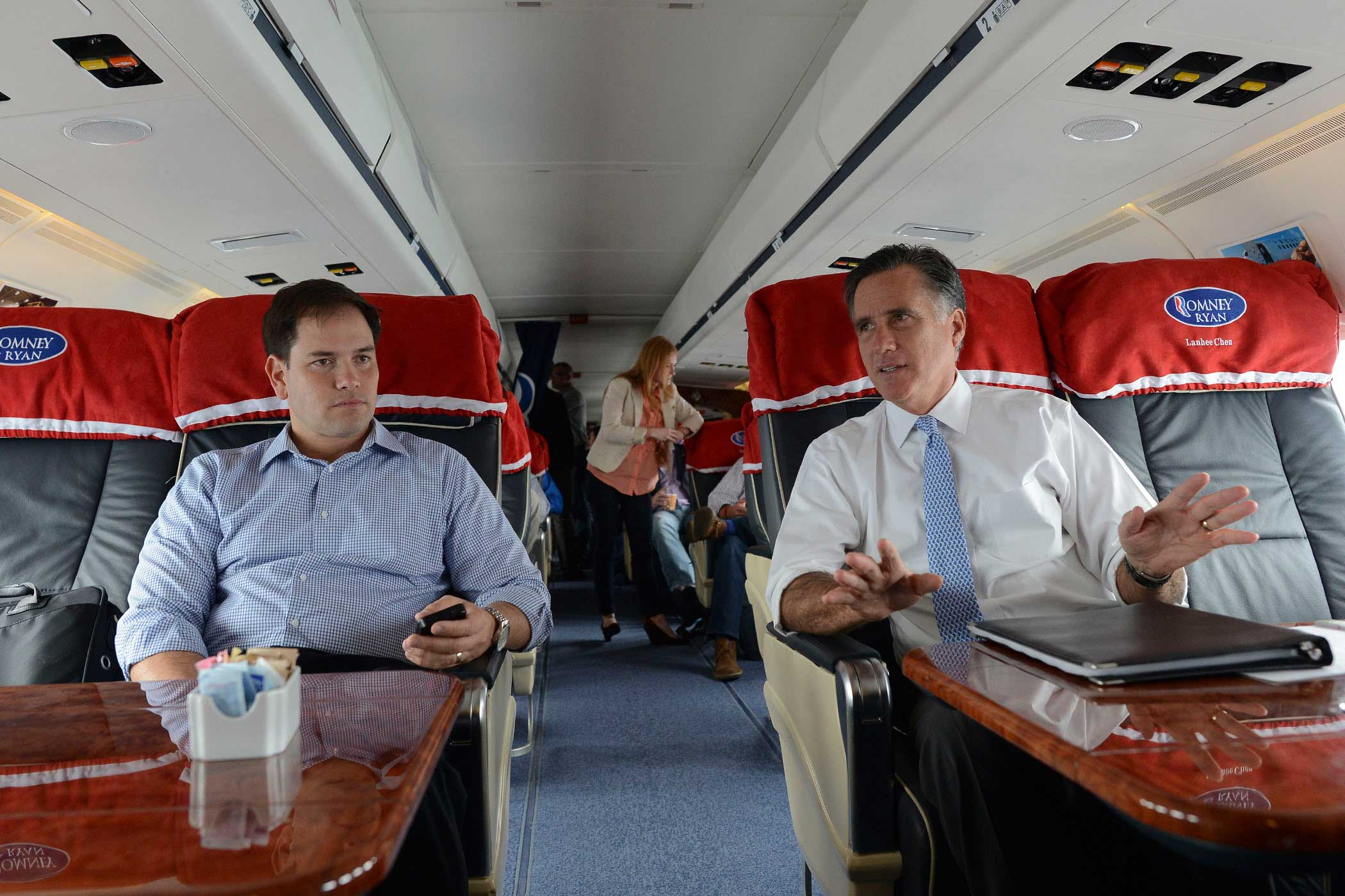 Former Republican Presidential candidate Mitt Romney speaks with Senator Marco Rubio while flying from Pensacola to Orlando, Fla., on Oct. 27, 2012.