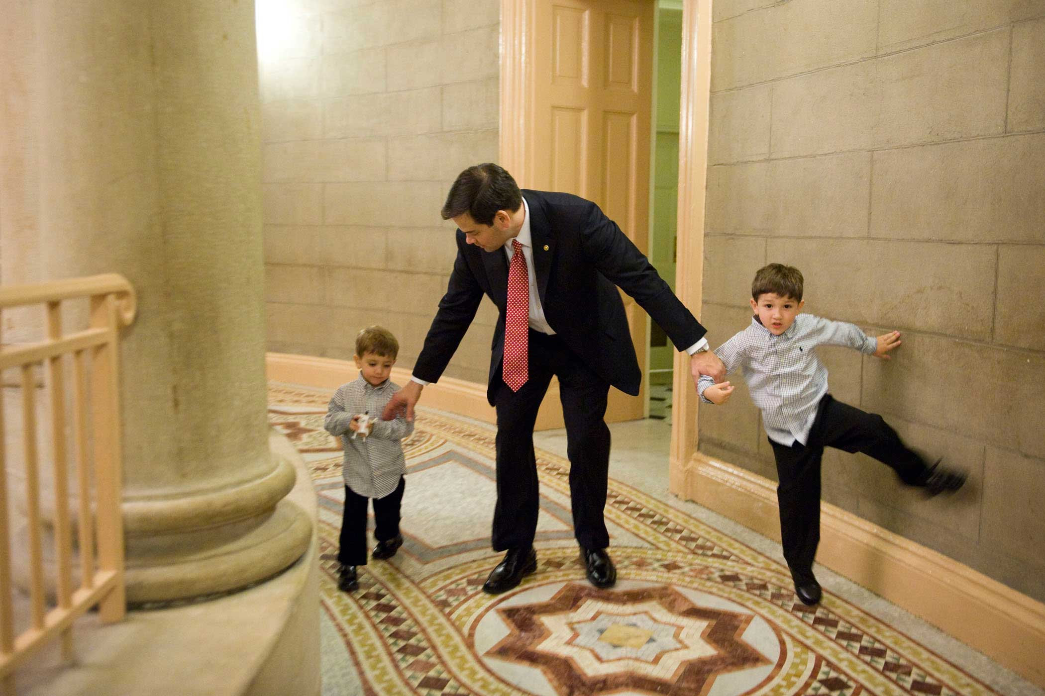 Marco Rubio and his sons Anthony, 5, right, and Dominic, 3, make their way to a swearing in ceremony for the 112th Congress in the Old Senate Chamber in Washington on Jan. 5, 2011.
