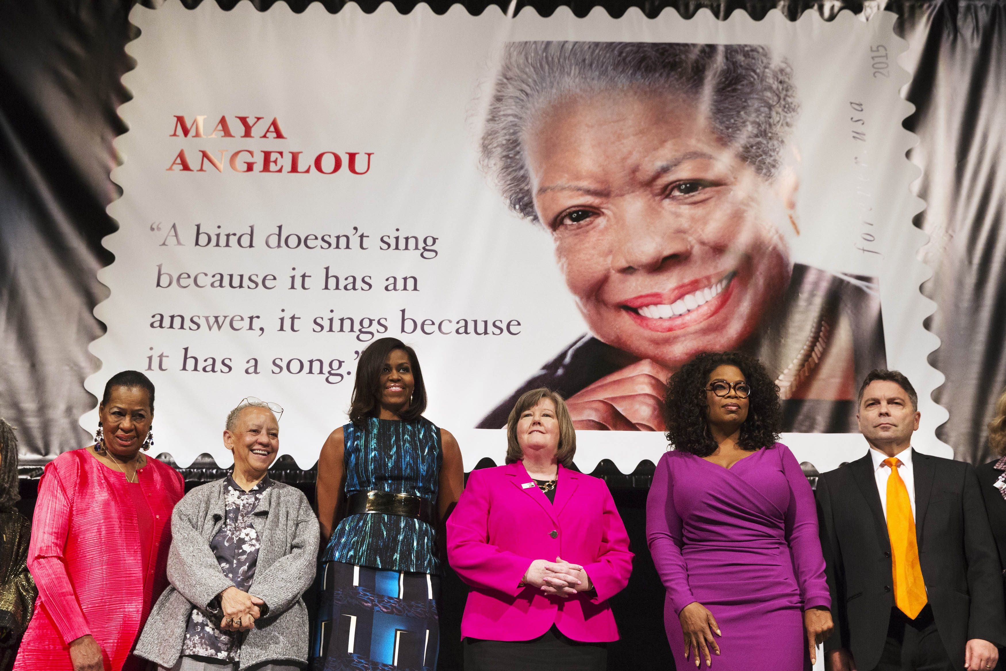 First lady Michelle Obama participates in the unveiling of the Maya Angelou Forever Stamp, Tuesday, April 7, 2015, at the Warner Theater in Washington D.C.