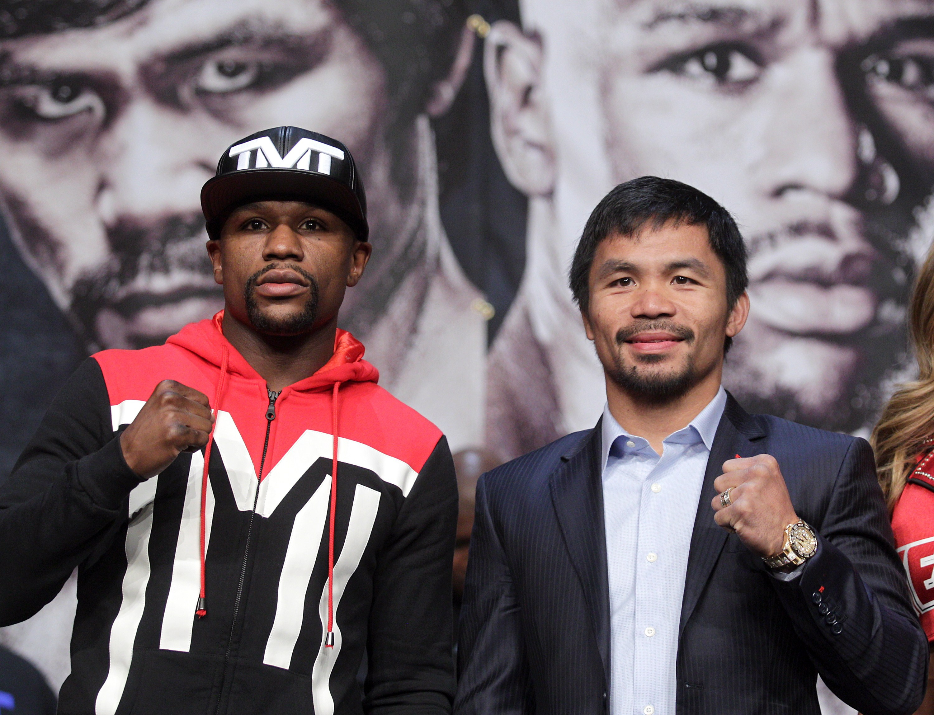 Enjoy it now, guys: Mayweather (left) and Pacquiao are heading for a pounding