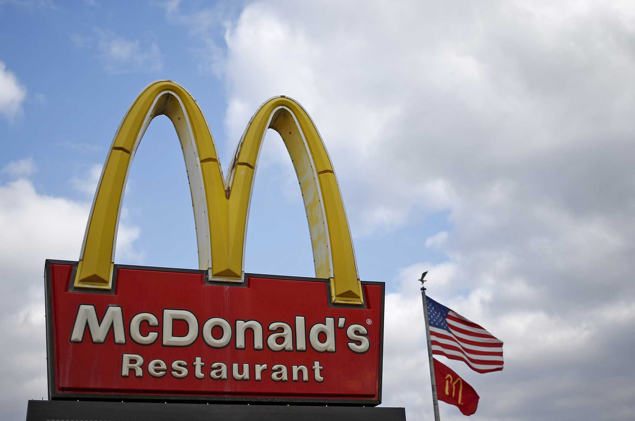 A McDonald's sign is seen outside one of its restaurants in Joliet, Illinois on March 26, 2015.