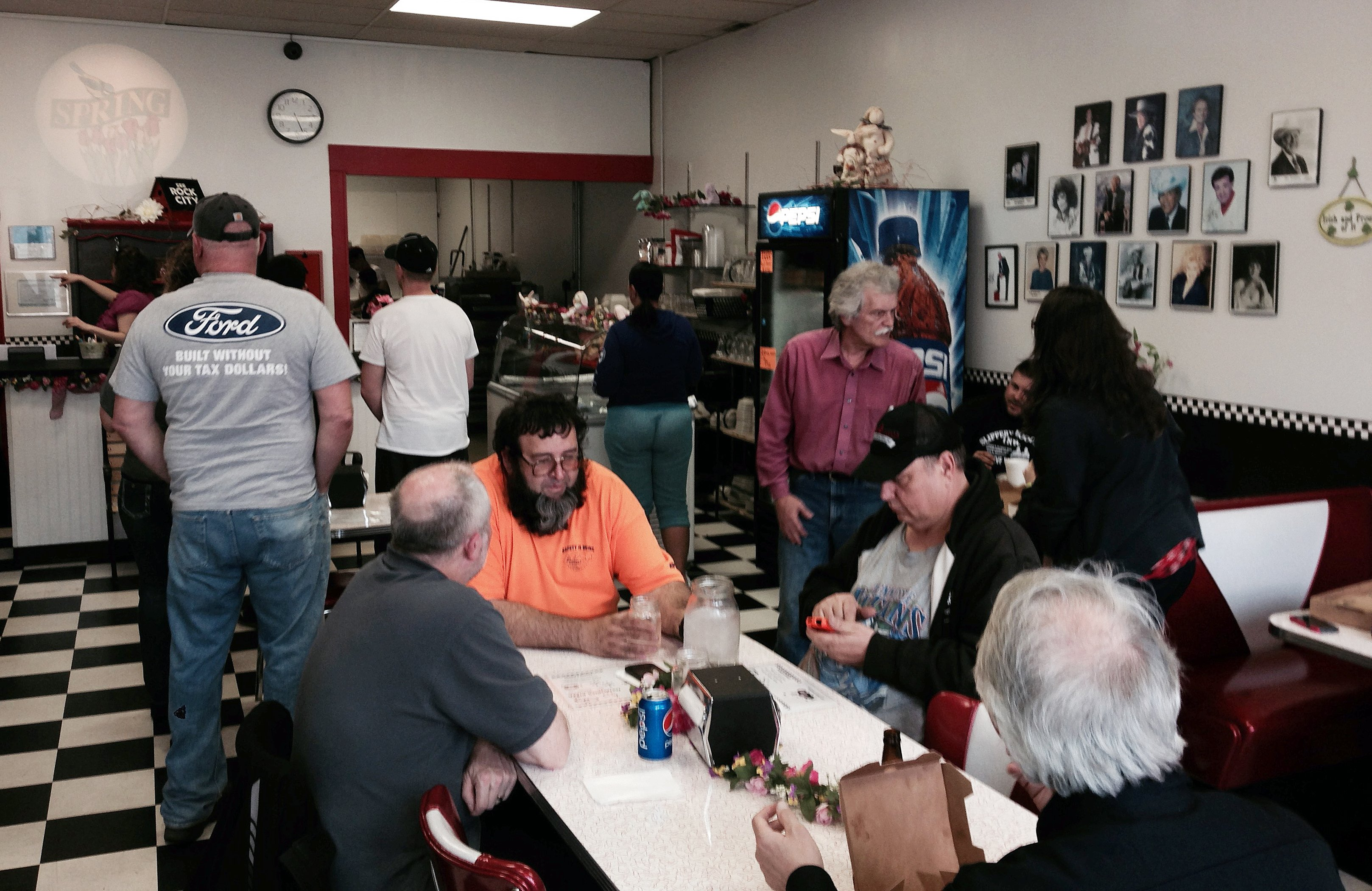 Many customers wait for service as Memories Pizza reopened for business on April, 9, 2015, in Walkerton, Ind.