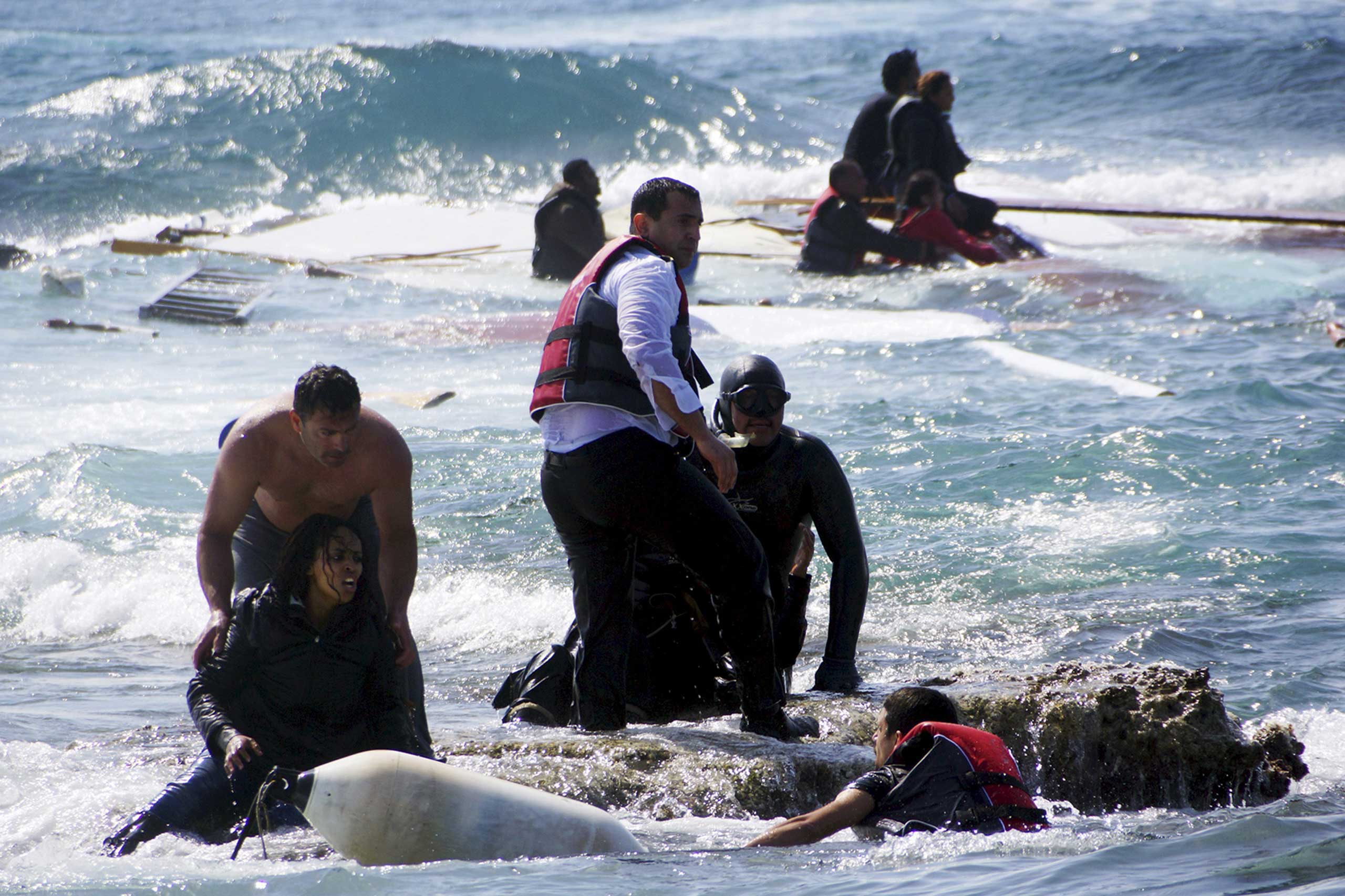 Migrants, who are trying to reach Greece, are rescued by members of the Greek Coast guard and locals near the coast of the southeastern island of Rhodes on April 20, 2015.
