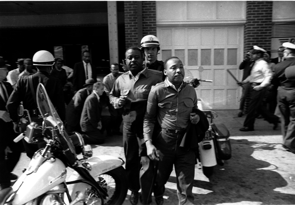 Rev. Ralph Abernathy, left, and Rev. Martin Luther King Jr., right are taken by a policeman as they led a line of demonstrators into the business section of Birmingham, Ala., on April 12, 1963. This is the photograph that ran with TIME's original coverage of their arrests.