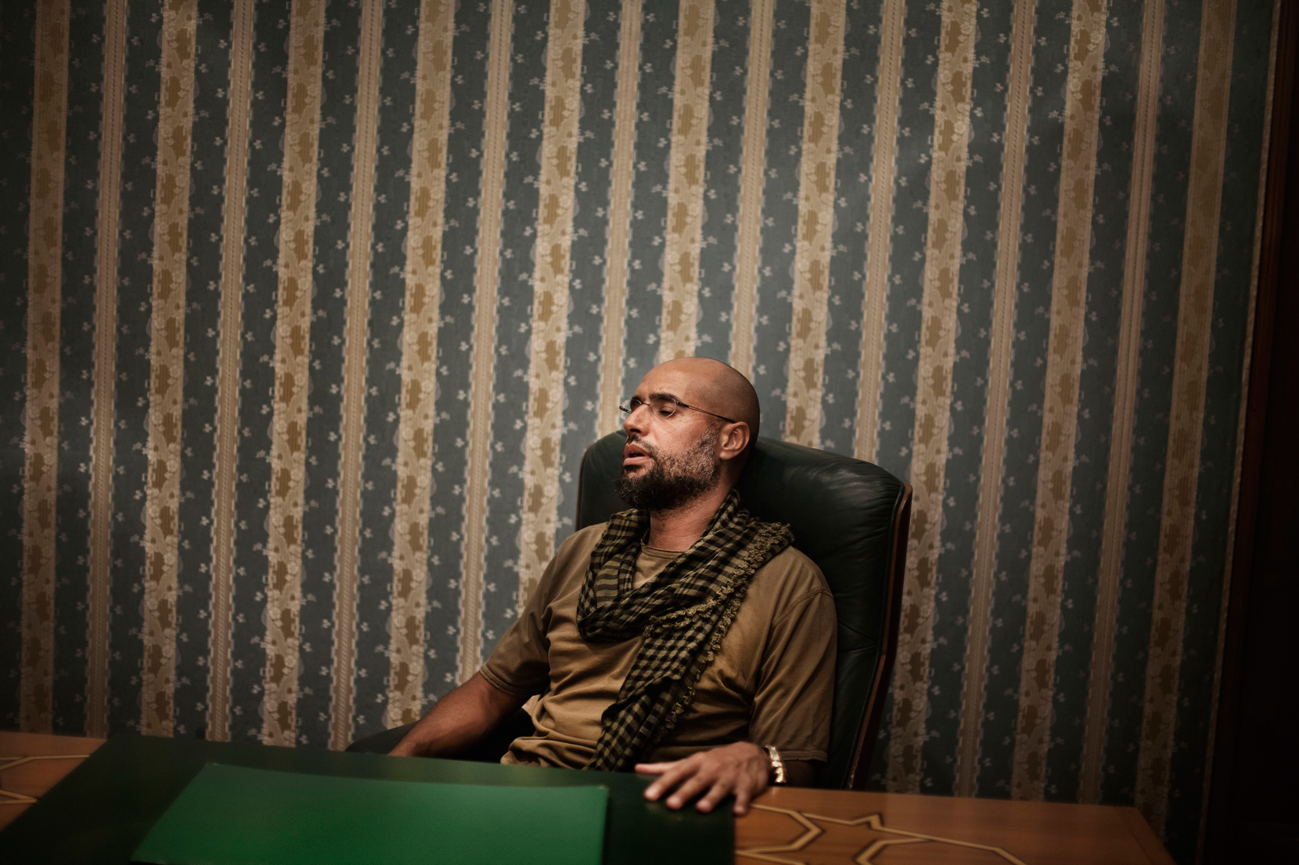 Saif al-Islam Gaddafi, son of Colonel Muammar Gaddafi, photographed in Tripoli, Libya on August 2, 2011 during an interview shortly before the city's fall.