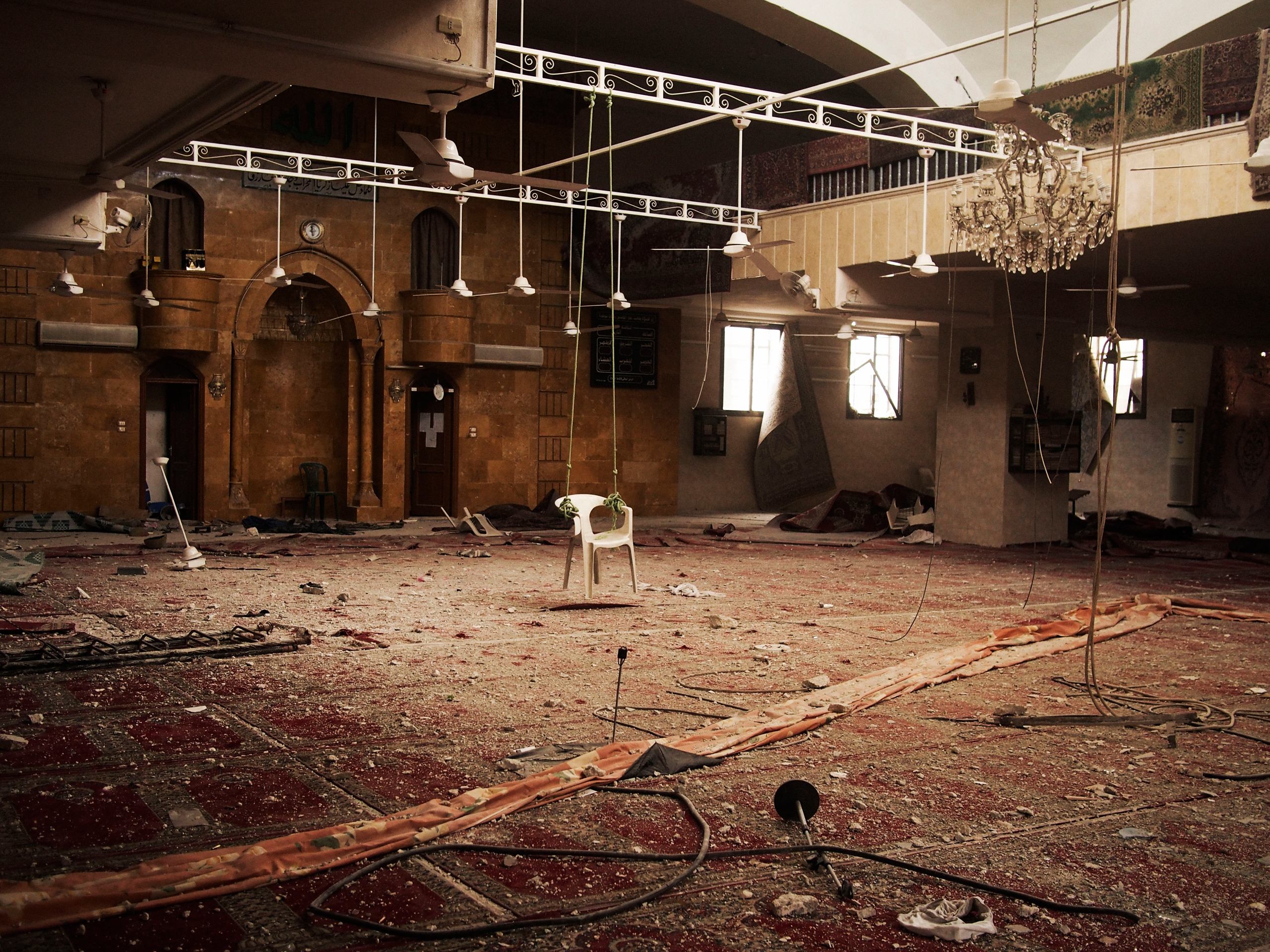A makeshift swing made with a plastic chair remains inside a mosque that was occupied by Syria Army soldiers in the front line of the Salahedin district of Aleppo, Syria on March 25, 2013.