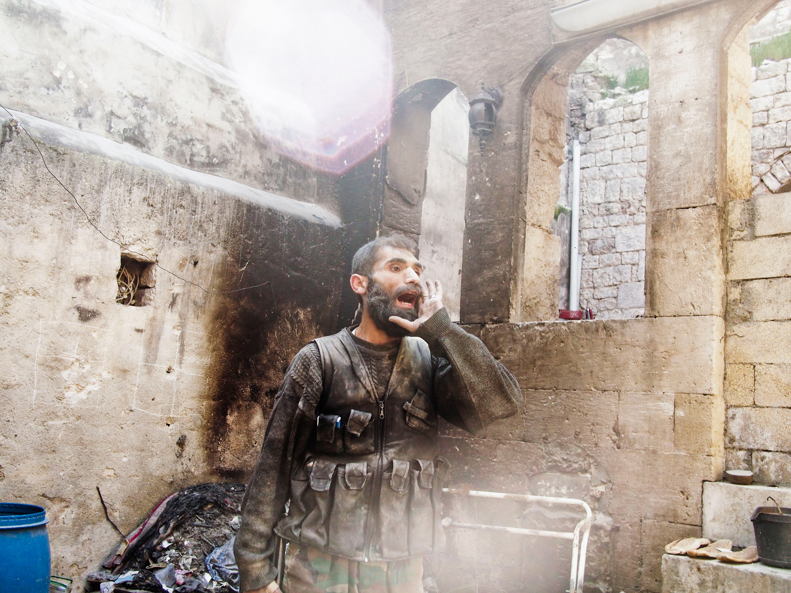 A rebel fighter in Aleppo, Syria yells  Allah u Akhbar  after the sound of an explosion could be heard close-by during fighting in Old City on March 26, 2013.