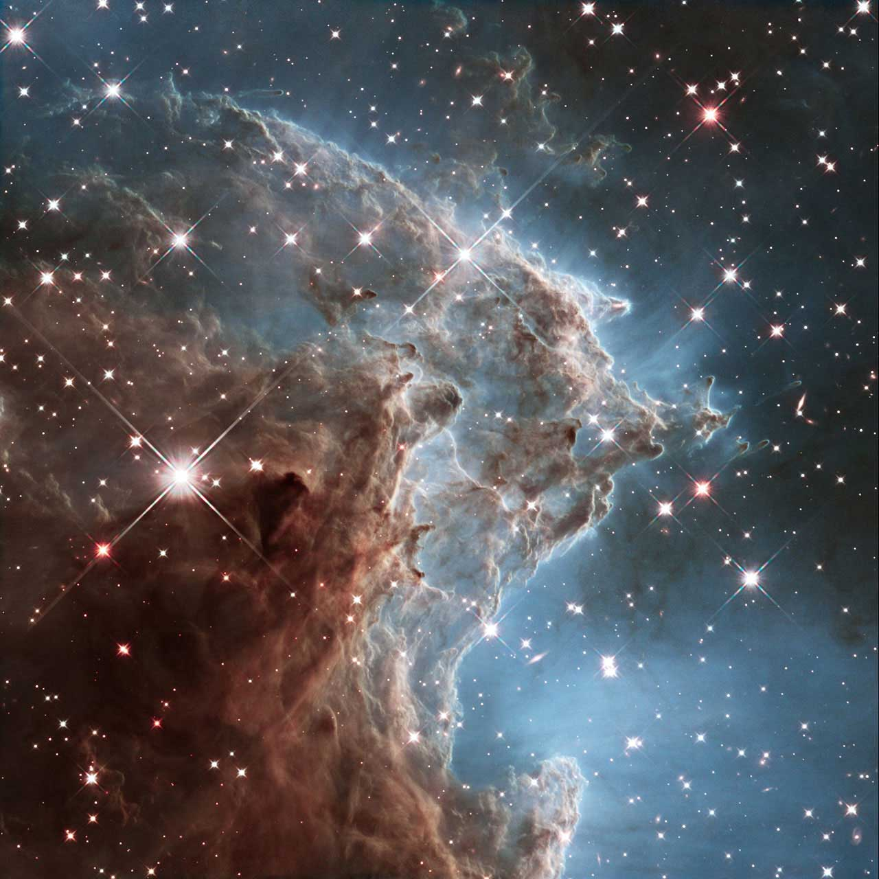Monkey Head Nebula:                                                              Also known as NGC 2174, the nebula lies about 6400 light-years away in the constellation of Orion (The Hunter). Hubble previously viewed this part of the sky back in 2011 — the colorful region is filled with young stars embedded within bright wisps of cosmic gas and dust. This portion of the Monkey Head Nebula was imaged in infrared using Hubble's Wide Field Camera 3.                                                              Image released on March 17, 2014