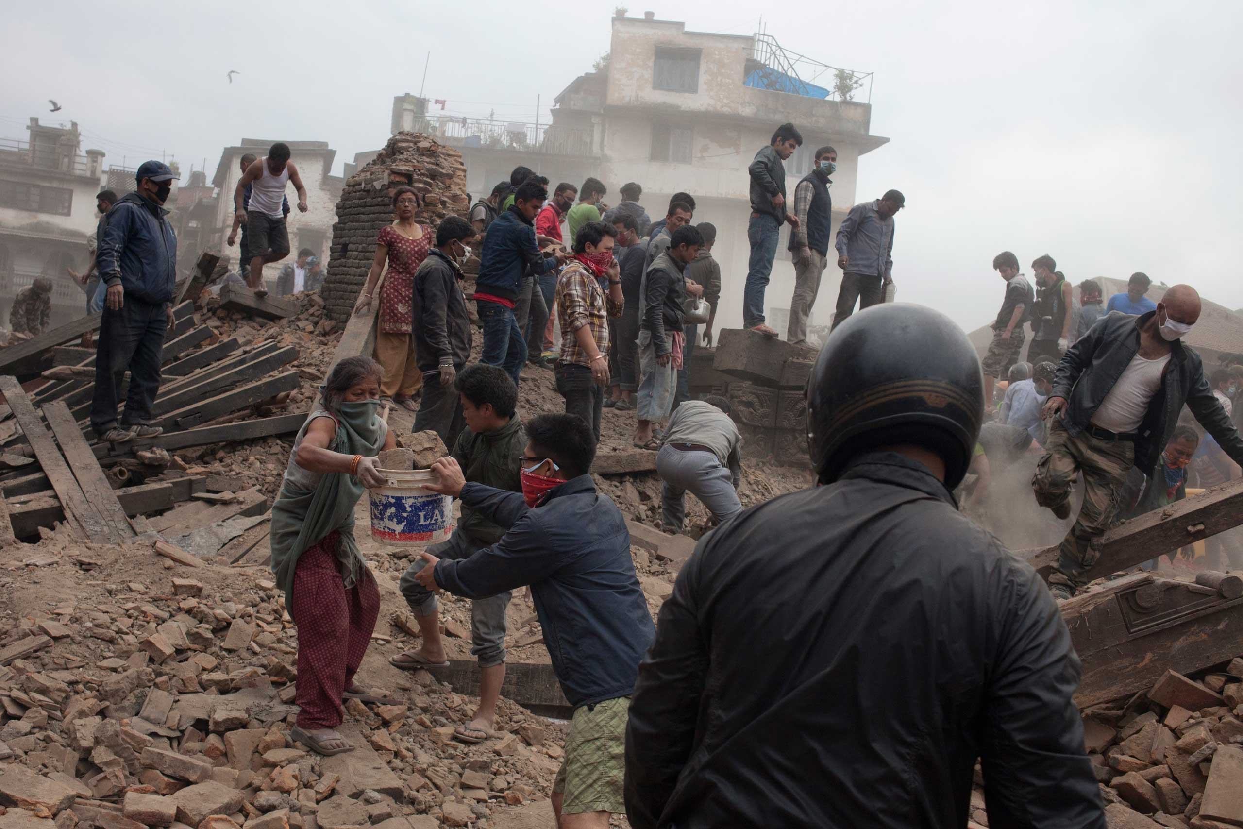 Security personnel and local people operating rescue operation at Basantapur Durbar Square in Kathmandu on April 25, 2015.