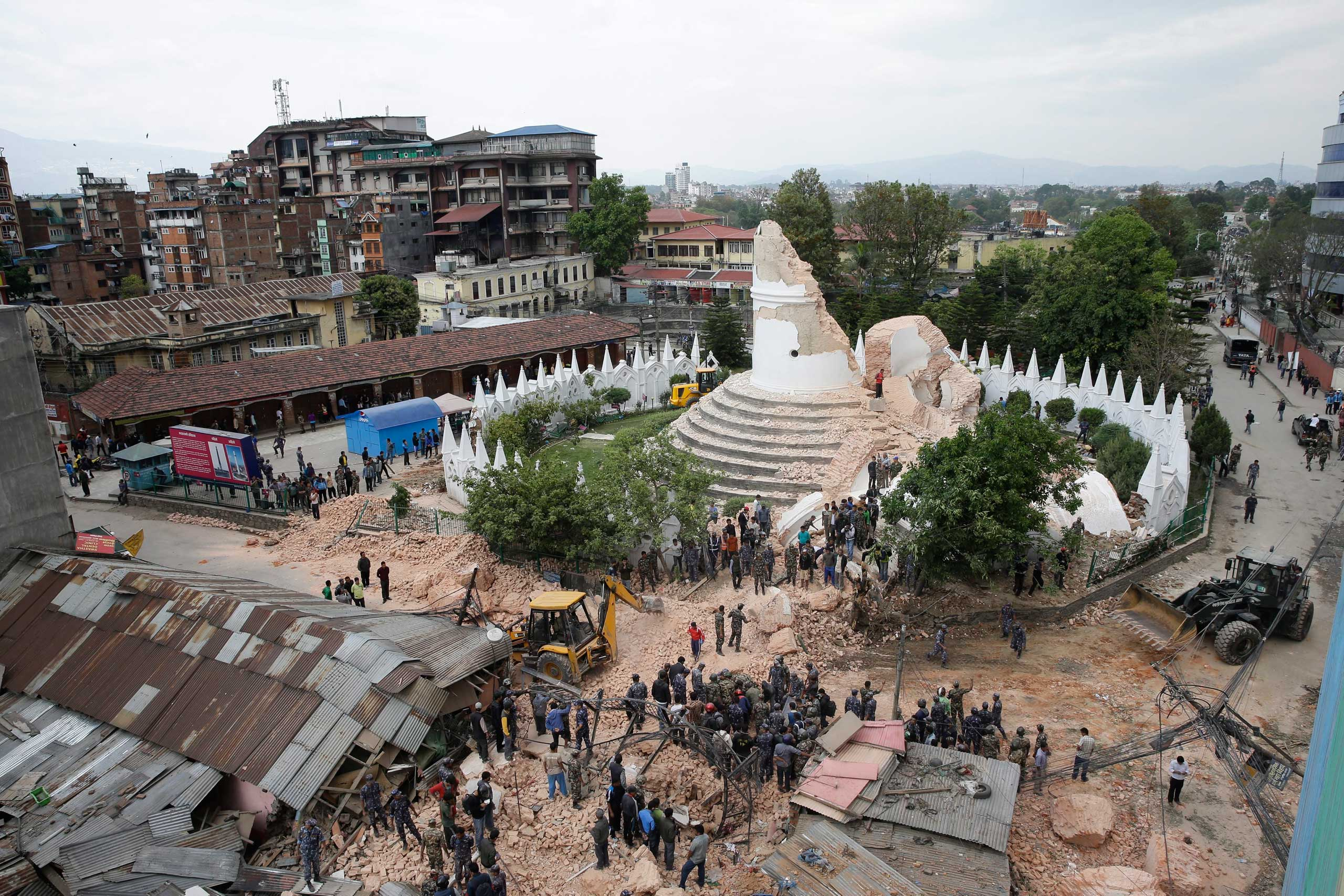 People inspect the damage of the collapsed landmark Dharahara, also called Bhimsen Tower, after the earthquake.