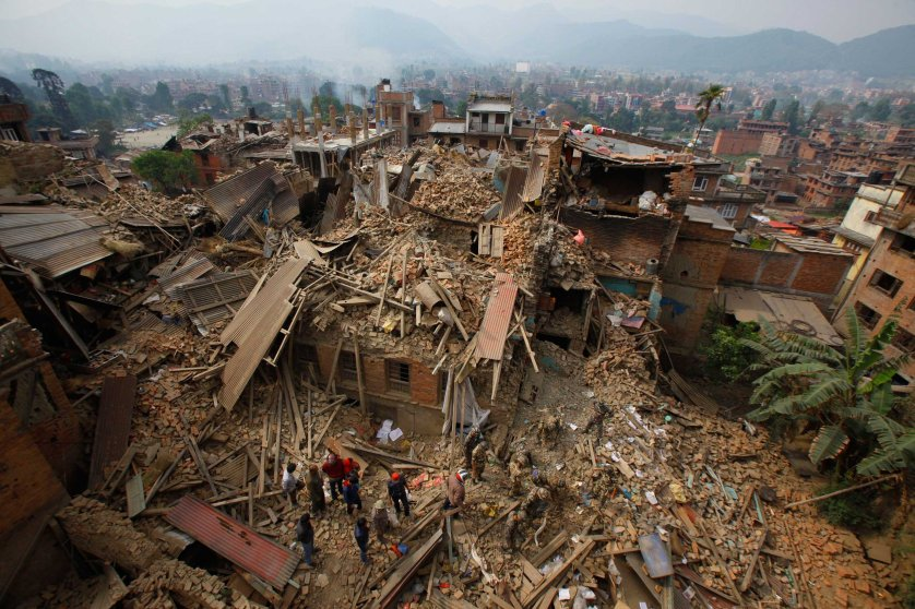 Rescue workers remove debris as they search for victims of earthquake in Bhaktapur near Kathmandu on April 26, 2015.