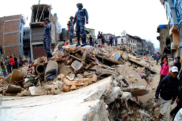 Search and rescue team work among the debris of houses after a powerful earthquake hits Katmandu, Nepal on April 26, 2015.