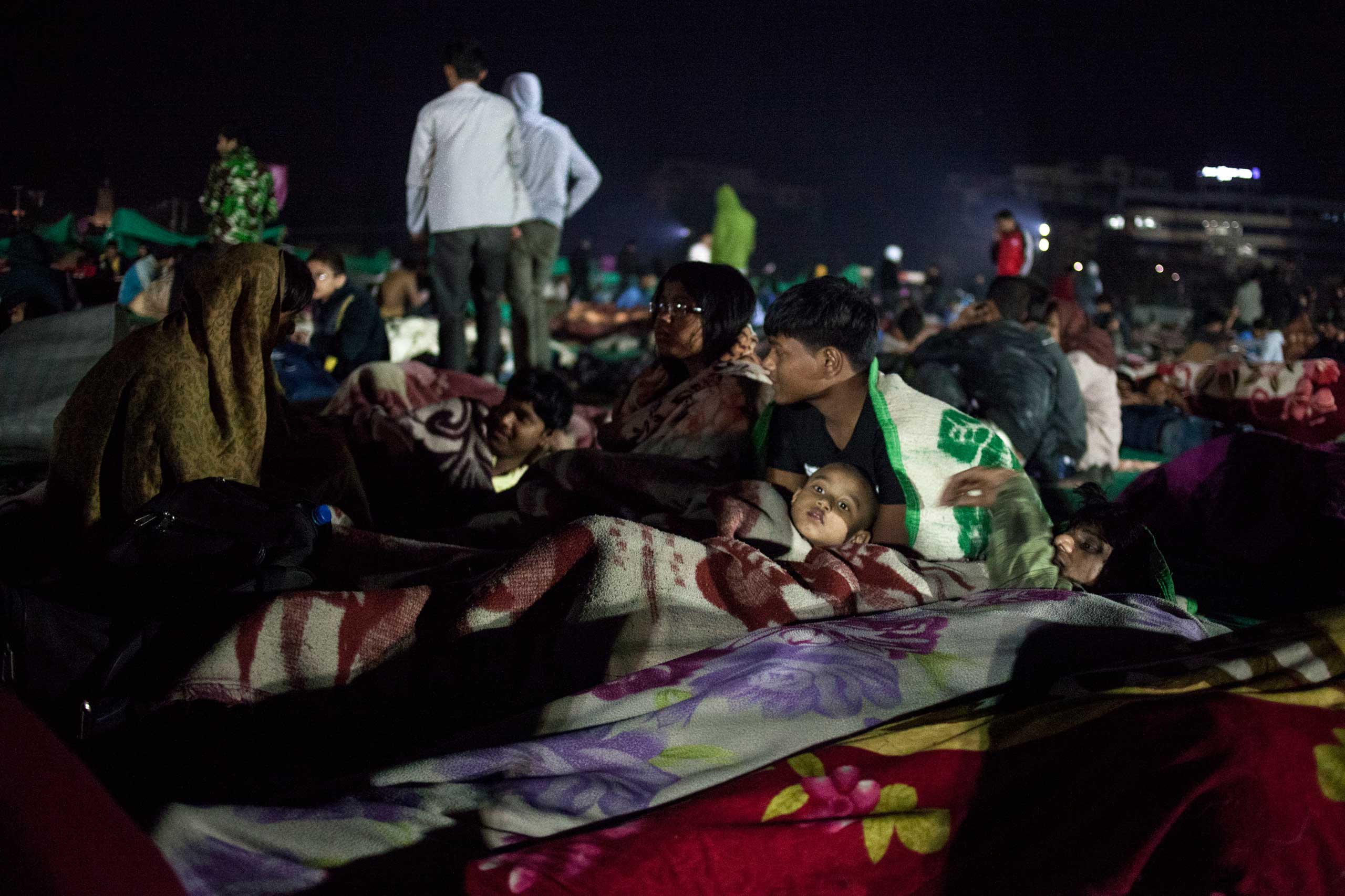 People gathered at Tundikhel, an open ground in central Kathmandu on April 25, 2015. Many families spent their nights there in fear of aftershocks.