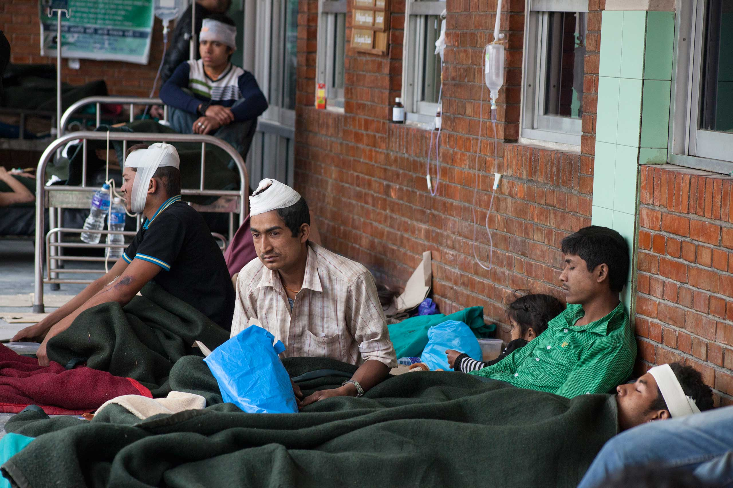 Injured people receive treatment at Tribhuvan University Teaching Hospital in Maharajgunj, Kathmandu, on April 26, 2015, one day after a massive earthquake hit Nepal.