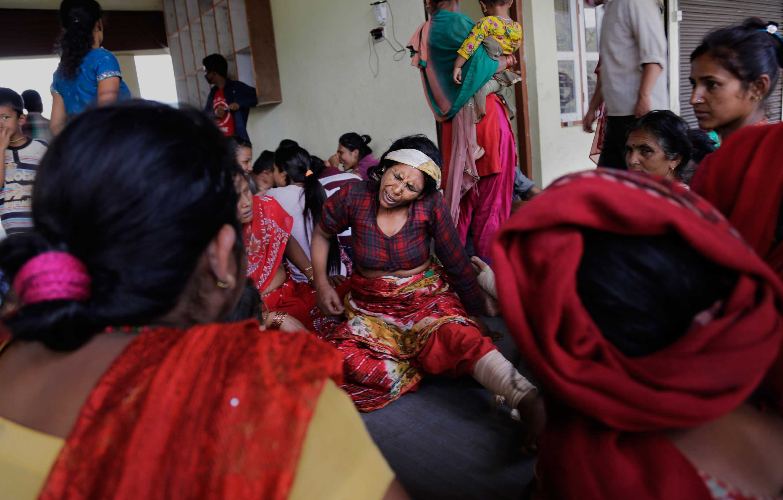 Nepalese villagers injured in Saturday's earthquake await evacuation at Trishuli Bazar in Nepal on April 27, 2015.