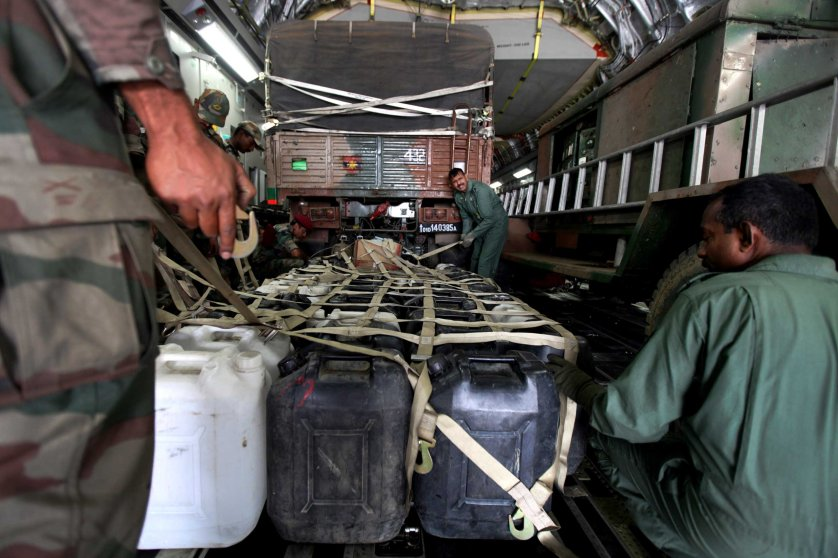 Plastic containers with drinking water are loaded into an Indian Air Force aircraft headed to Nepal, at a base near New Delhi on April 26, 2015.