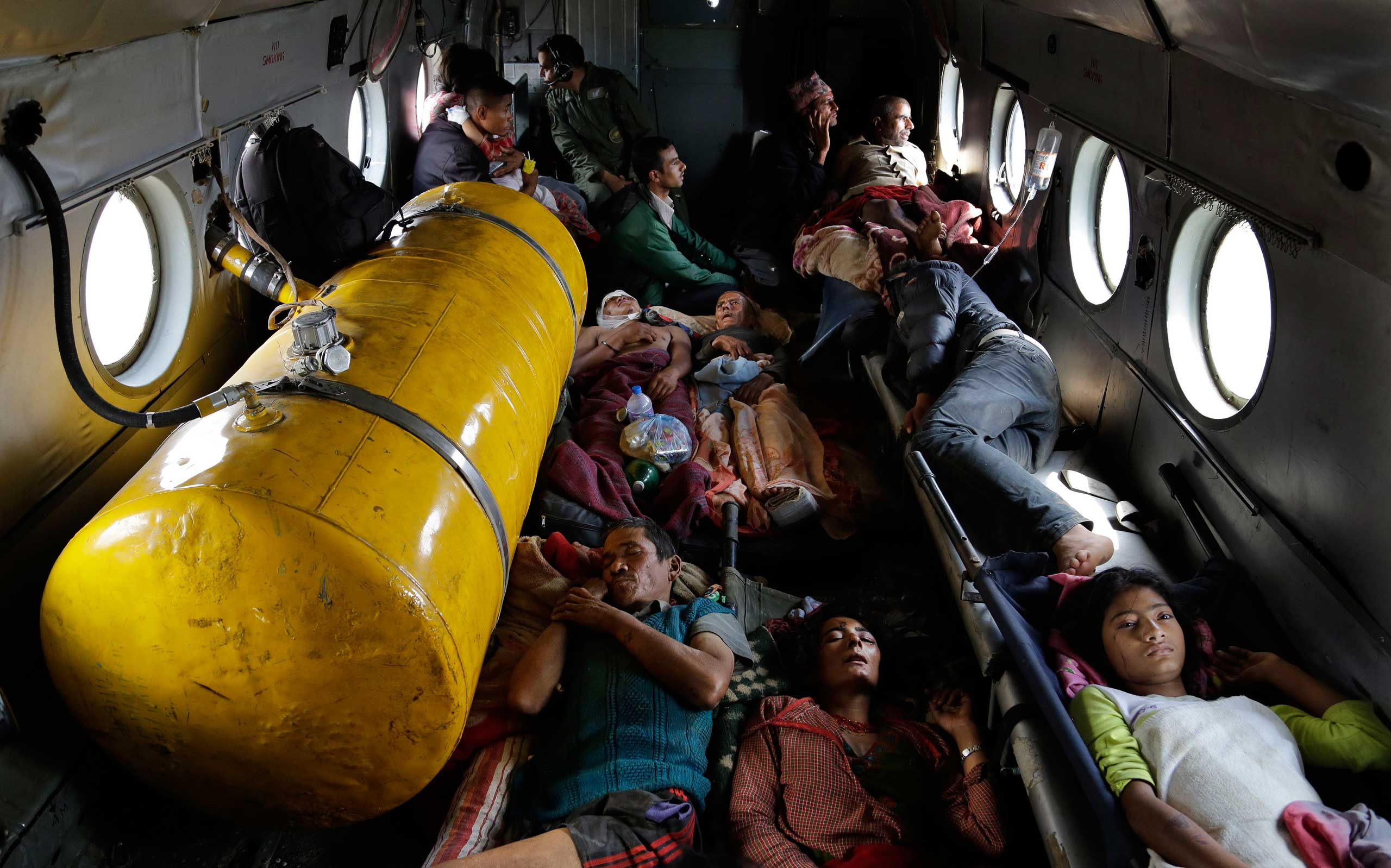 Nepalese victims of Saturday's earthquake lie inside an Indian Air Force helicopter as they are evacuated from Trishuli Bazar to Kathmandu airport in Nepal on April 27, 2015.