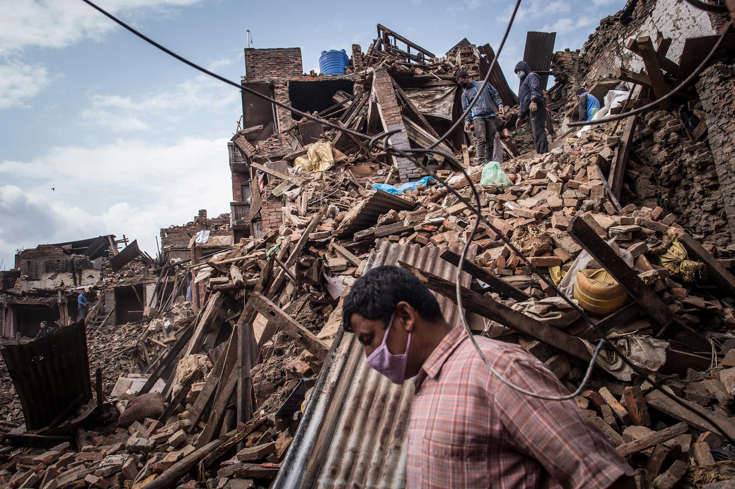 Nepalese victims of the earthquake search for their belongings among debris of their homes in Bhaktapur, Nepal, on April 29, 2015.