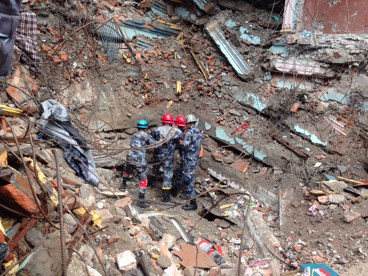 The first rescue team arriving at the scene where Pemba Tamang, 15, had been trapped for five days in Kathmandu, Nepal, April 30, 2015
