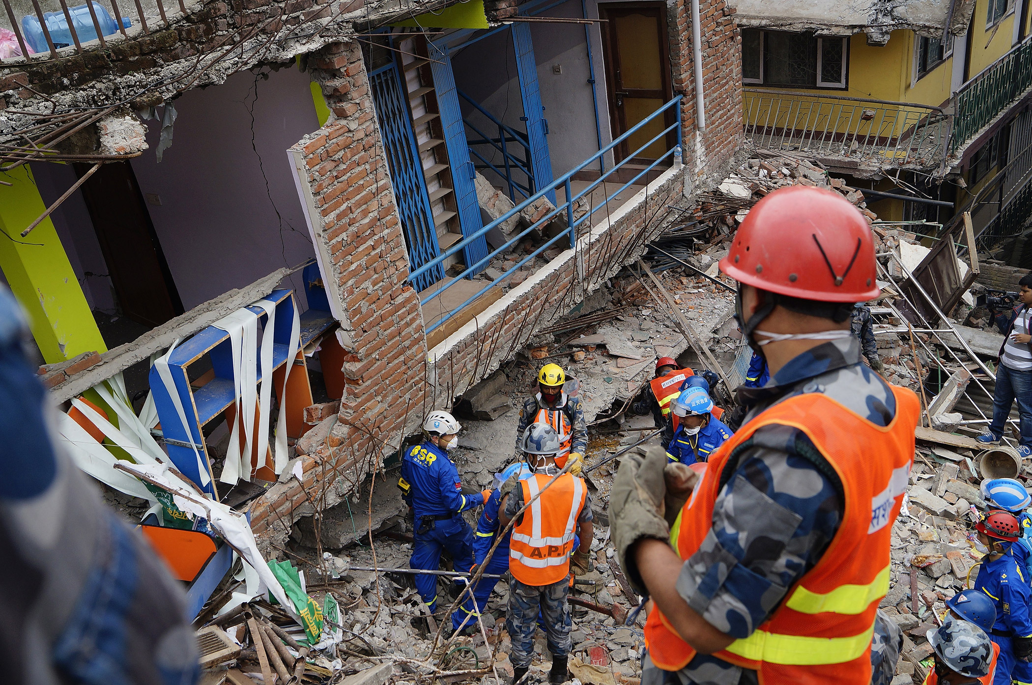 Nepalese and Chinese rescue teams look for earthquake victims in debris in Kathmandu, Nepal on April 28, 2015.