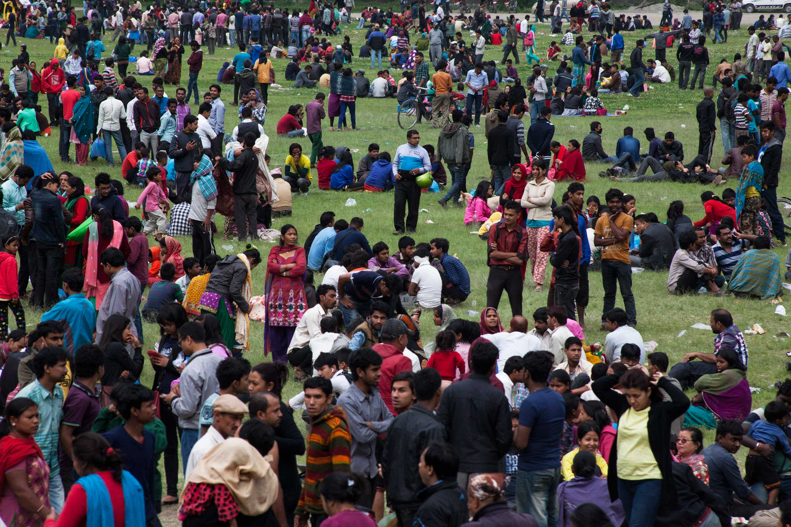 People stay outdoors in fear of aftershocks, in central Kathmandu.