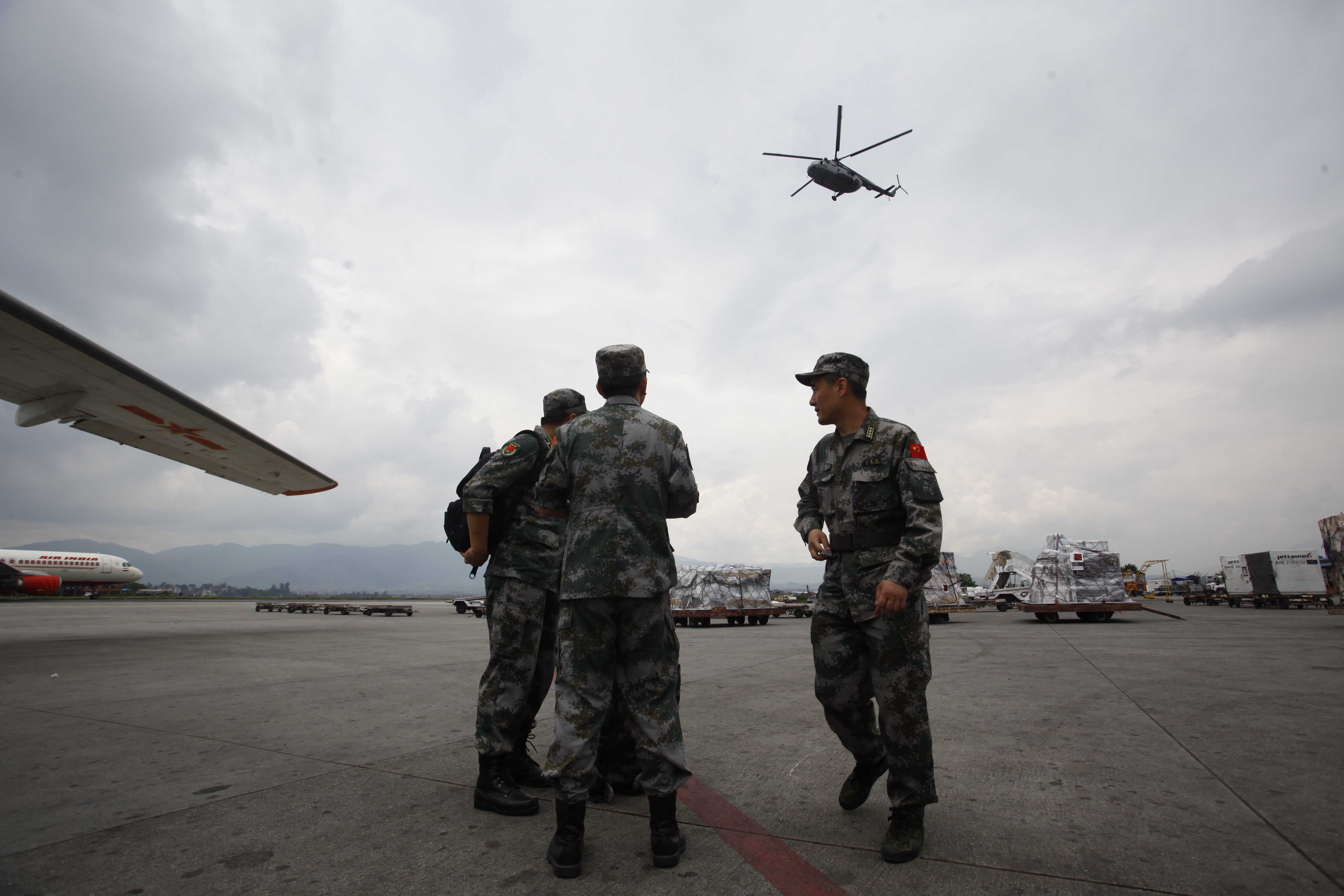 Members of Chinese People's Liberation Army Air Force arrive in Nepal to provide aid following Saturday's earthquake at Tribhuvan International Airport in Kathmandu, Nepal on April 28, 2015.