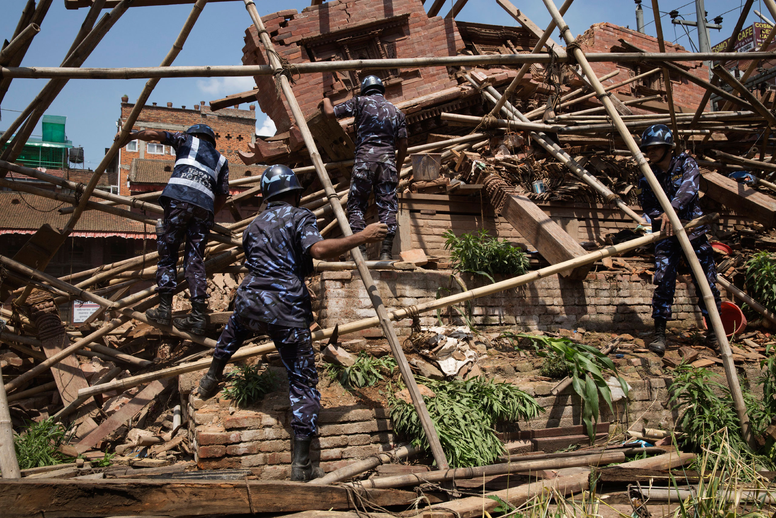 Nepalese forces clear fallen bamboo from ruins in Durbar Square, Kathmandu, April 26, 2015.