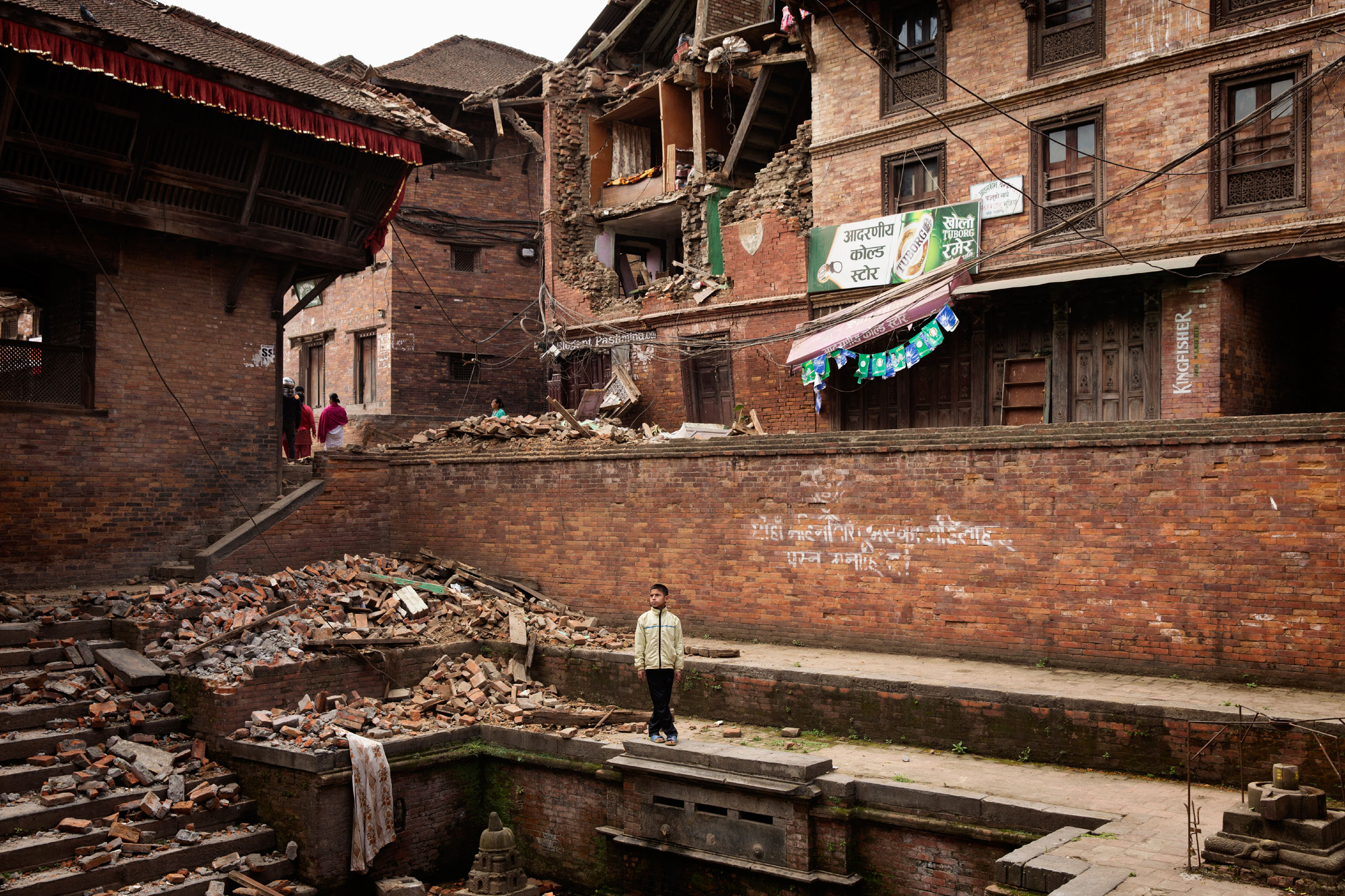 A Nepalese boy stands amid earthquake damage in the ancient city of Bhaktapur in the Kathmandu Valley, April  28, 2015, three days after a 7.8-magnitude earthquake had hit the country.