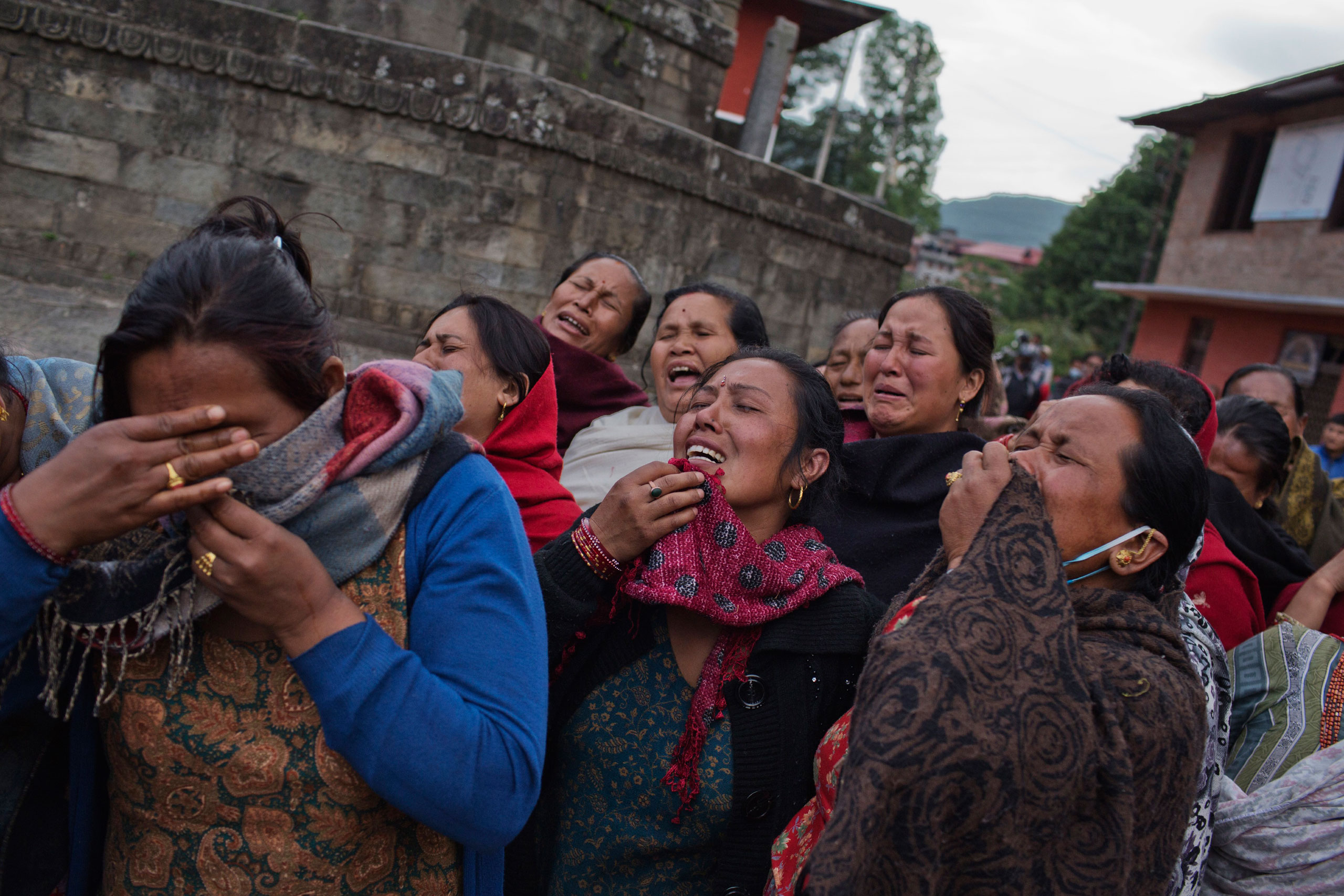 Nepalese women mourn relatives lost in the earthquake in Bhaktapur, in the Kathmandu Valley, April 29, 2015.
