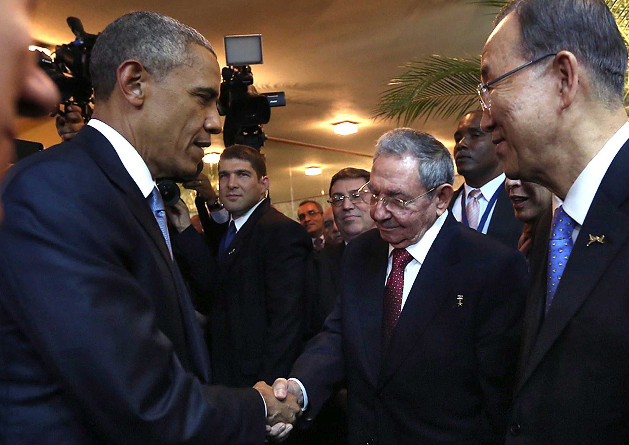 Cuban President Raul Castro (2-R) and US President Barack Obama (L) shaking hands as Castro's grandson and bodyguard Raul Rodriguez Castro (2-L), Cuban Foreign Minister Bruno Rodriguez (C) and United Nations chief Ban Ki-moon (R) look on, moments before the opening ceremony of the VII Americas Summit, in Panama City on April 10, 2015.