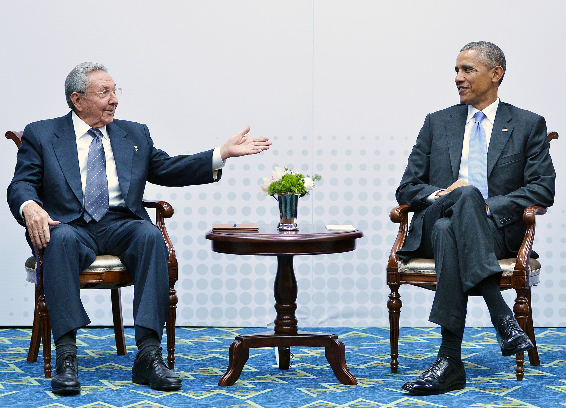 Cuba's President Raul Castro, left, speaks during a meeting with President Barack Obama on the sidelines of the Summit of the Americas at the ATLAPA Convention center on April 11, 2015 in Panama City, Panama.