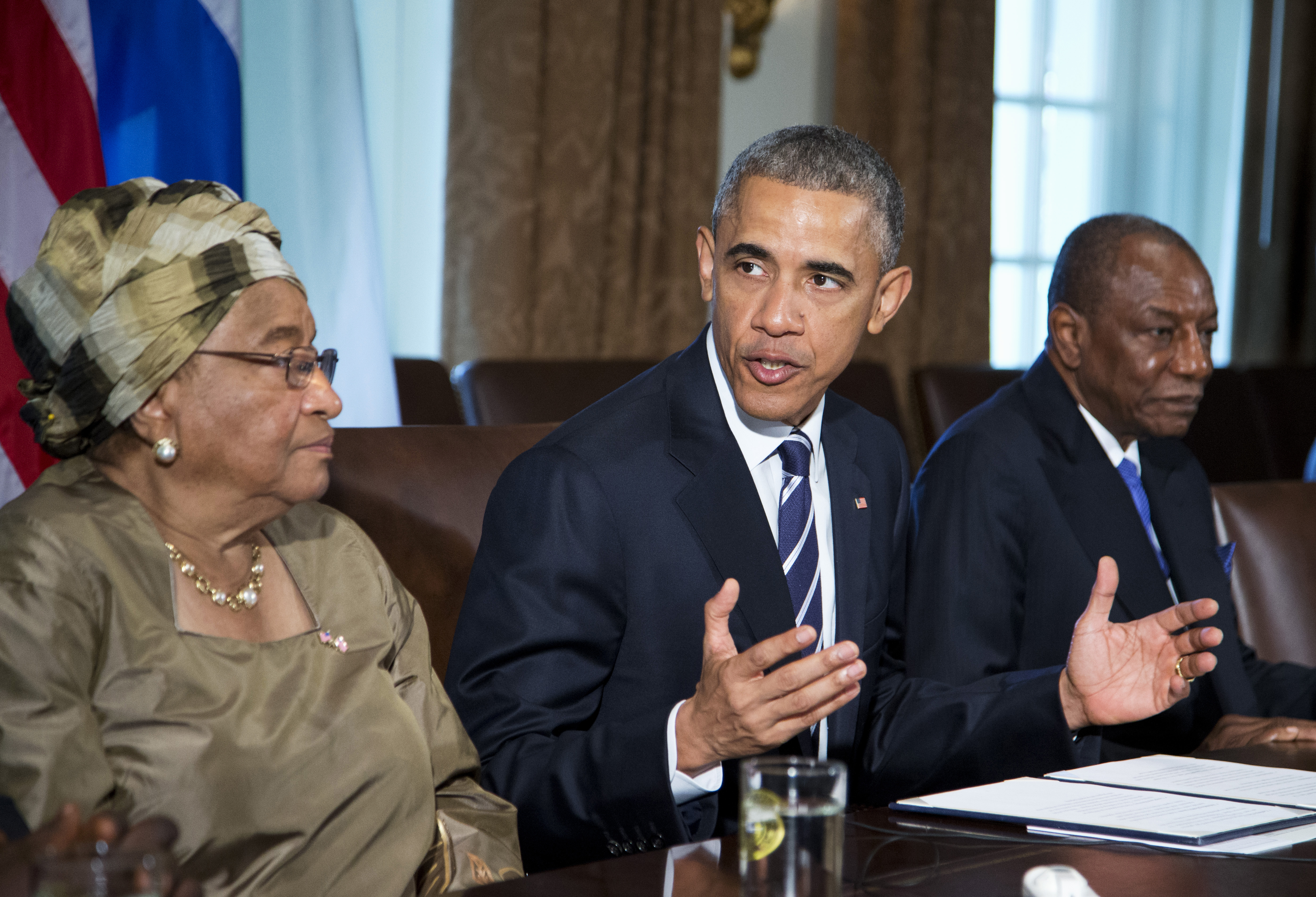 President Barack Obama, flanked by Liberian President Ellen Johnson Sirleaf, left, and Guinean President Alpha Condé, speaks in the Cabinet Room of the White House in Washington, Wednesday, April 15, 2015, to discuss the progress made in the international Ebola response.