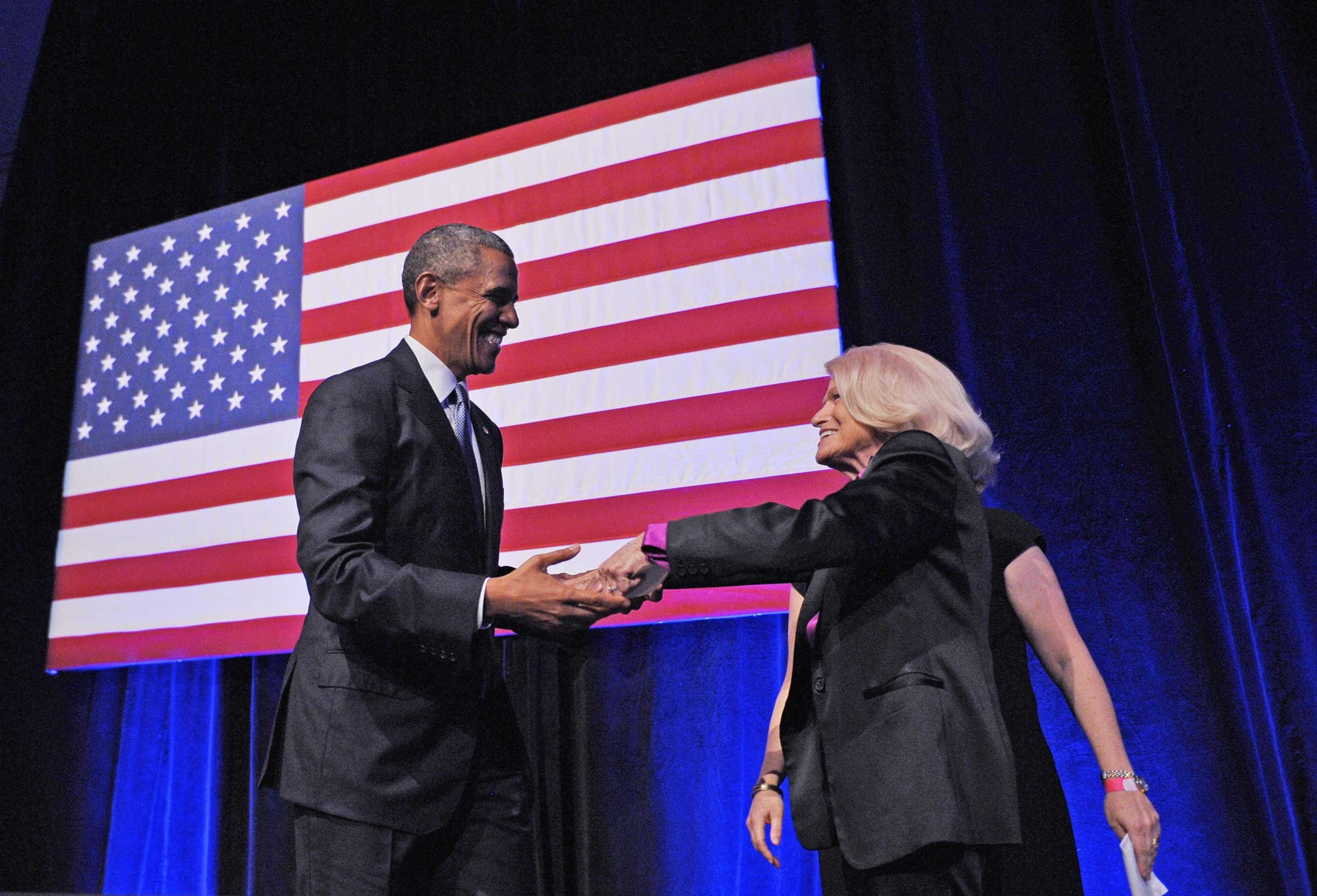 President Barack Obama holds hands with Edie Windsor after she introduced him during the Democratic National Committee LGBT Gala at Gotham Hall in New York City on June 17, 2014.
