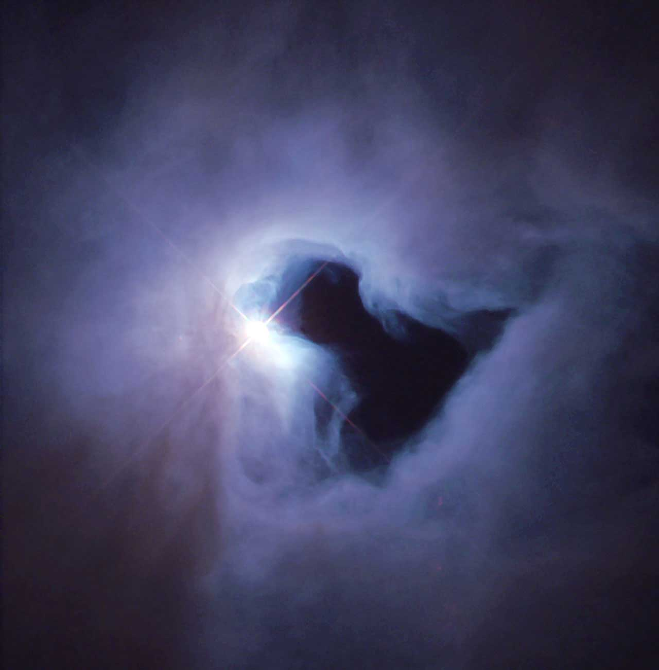<strong>NGC 1999</strong>:                                   NGC 1999 is an example of a reflection nebula. A reflection nebula shines only because the light from an embedded source illuminates its dust; the nebula does not emit any visible light of its own. NGC 1999 lies close to the Orion Nebula, about 1,500 light-years from Earth, in a region of our Milky Way galaxy where new stars are being formed actively.                                   <i>Image released on March 2, 2000</i>