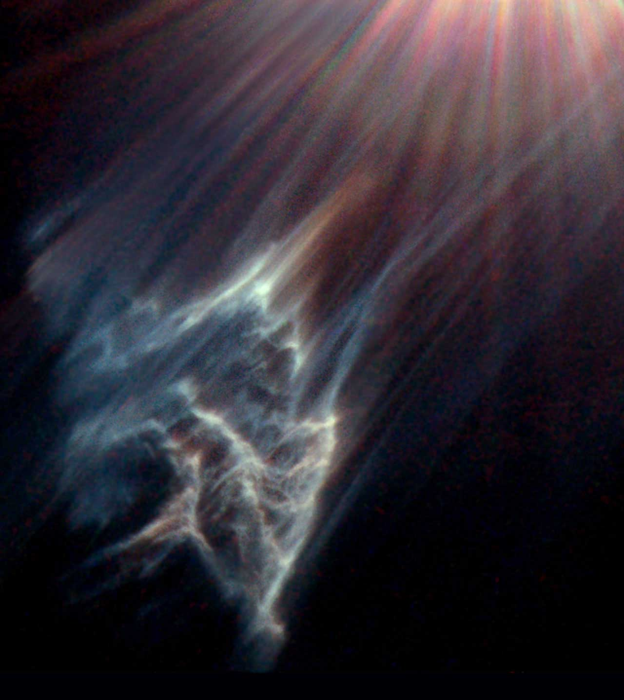 <strong>Pleiades</strong>:                                   This image shows the wispy tendrils of a dark interstellar cloud being destroyed by the passage of one of the brightest stars in the Pleiades star cluster. The star is reflecting light off the surface of pitch black clouds of cold gas laced with dust. These are called reflection nebulae. Resembling a small dipper, this star cluster lies in the constellation Taurus at a distance of about 380 light-years from Earth                                   <i>Image released on Dec. 6, 2000</i>