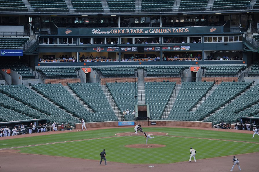 The Baltimore Orioles bat against the Chicago White Sox during a baseball game without fans on April 29, 2015, in Baltimore. Due to security concerns the game was closed to the public.