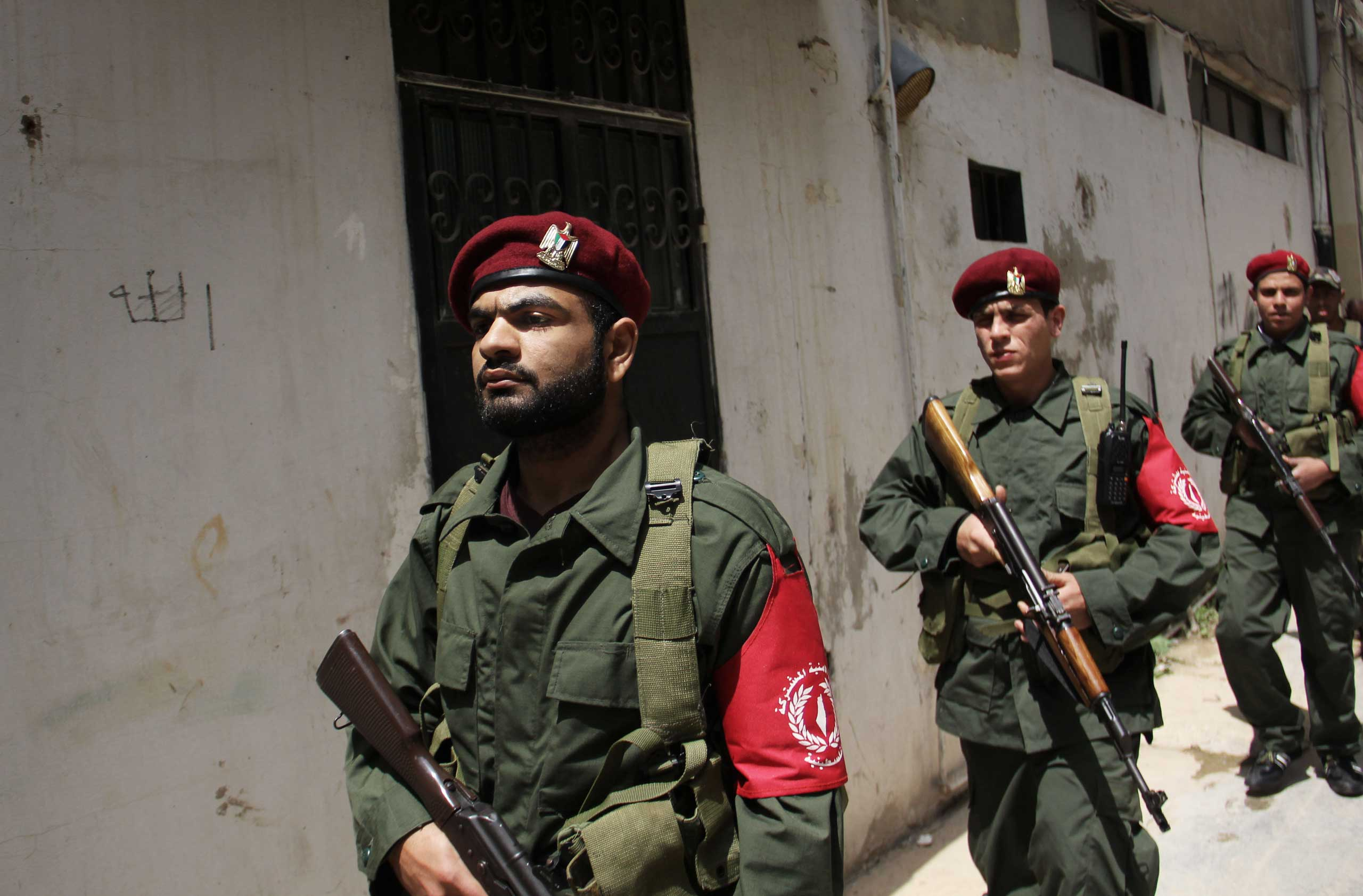 Members of a new Palestinian joint force patrol in Palestinian refugee camp Ain el-Helweh, in Lebanon on April 19, 2015.
