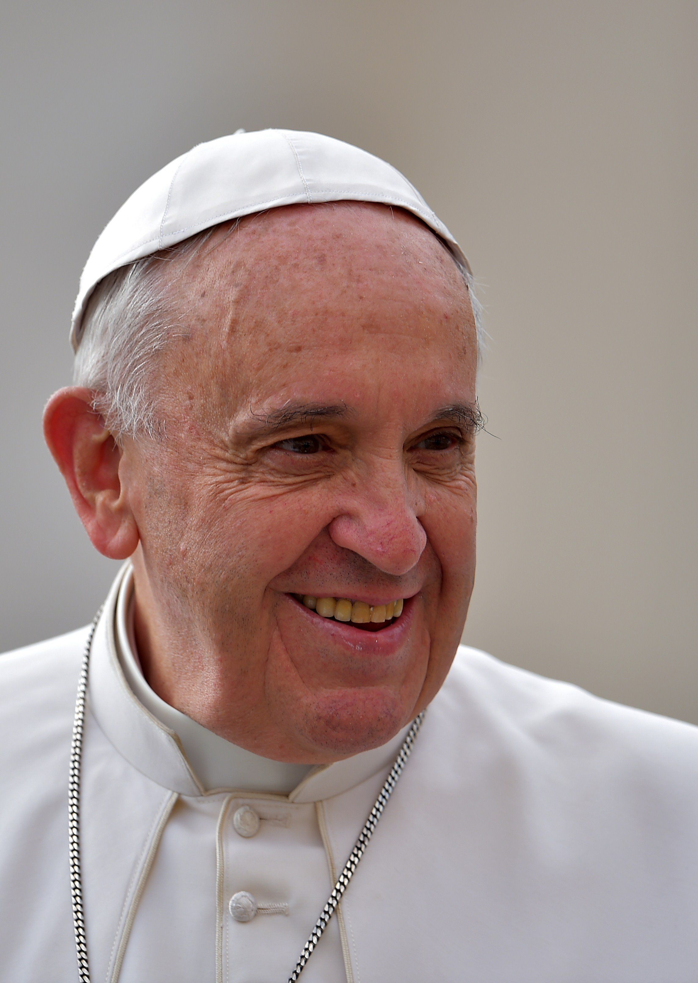 Pope Francis smiles as he arrives to lead his open-air weekly audience in St. Peter's square on April 29, 2015 at the Vatican.