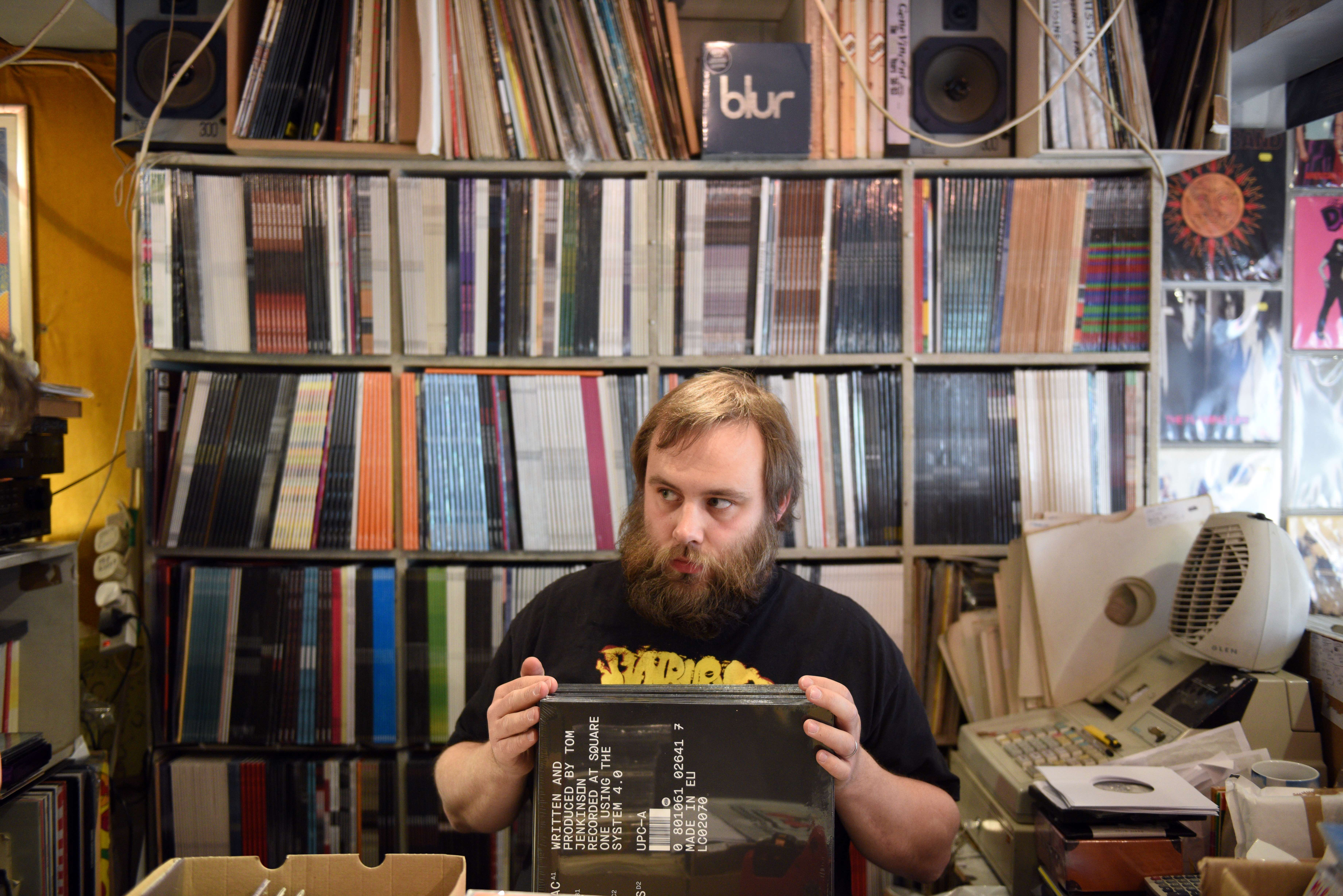 Joe Blanchard, an employee of the music shop 'Record Collector', arranges their vinyl stock ahead of tomorrow's 'Record Store Day' in Sheffield, Northern England on April 17, 2015.