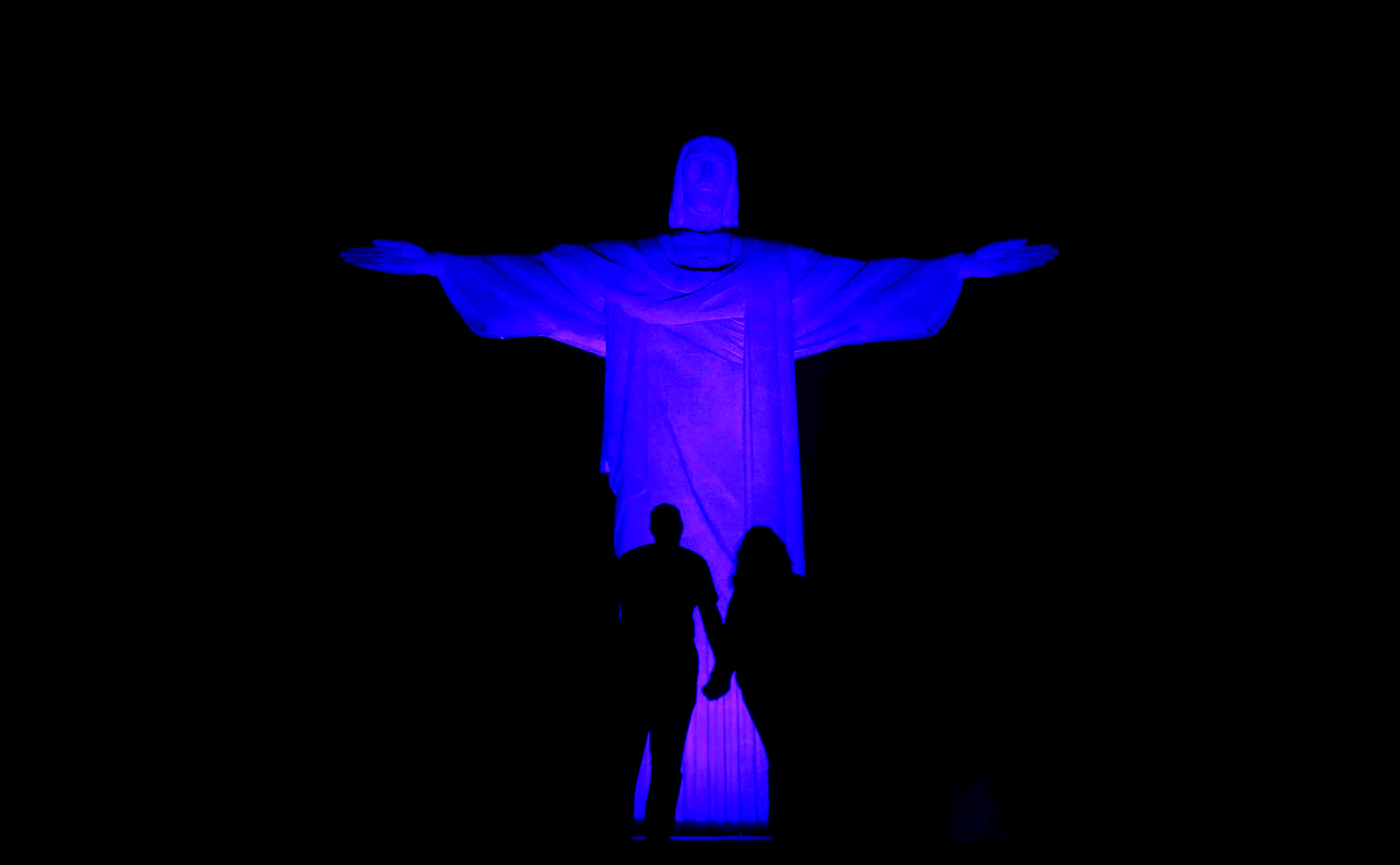 The statue of Christ the Redeemer is lit up in blue for the  Light It Up Blue  campaign to mark the World Autism Awareness Day in Rio de Janeiro April 1, 2015.