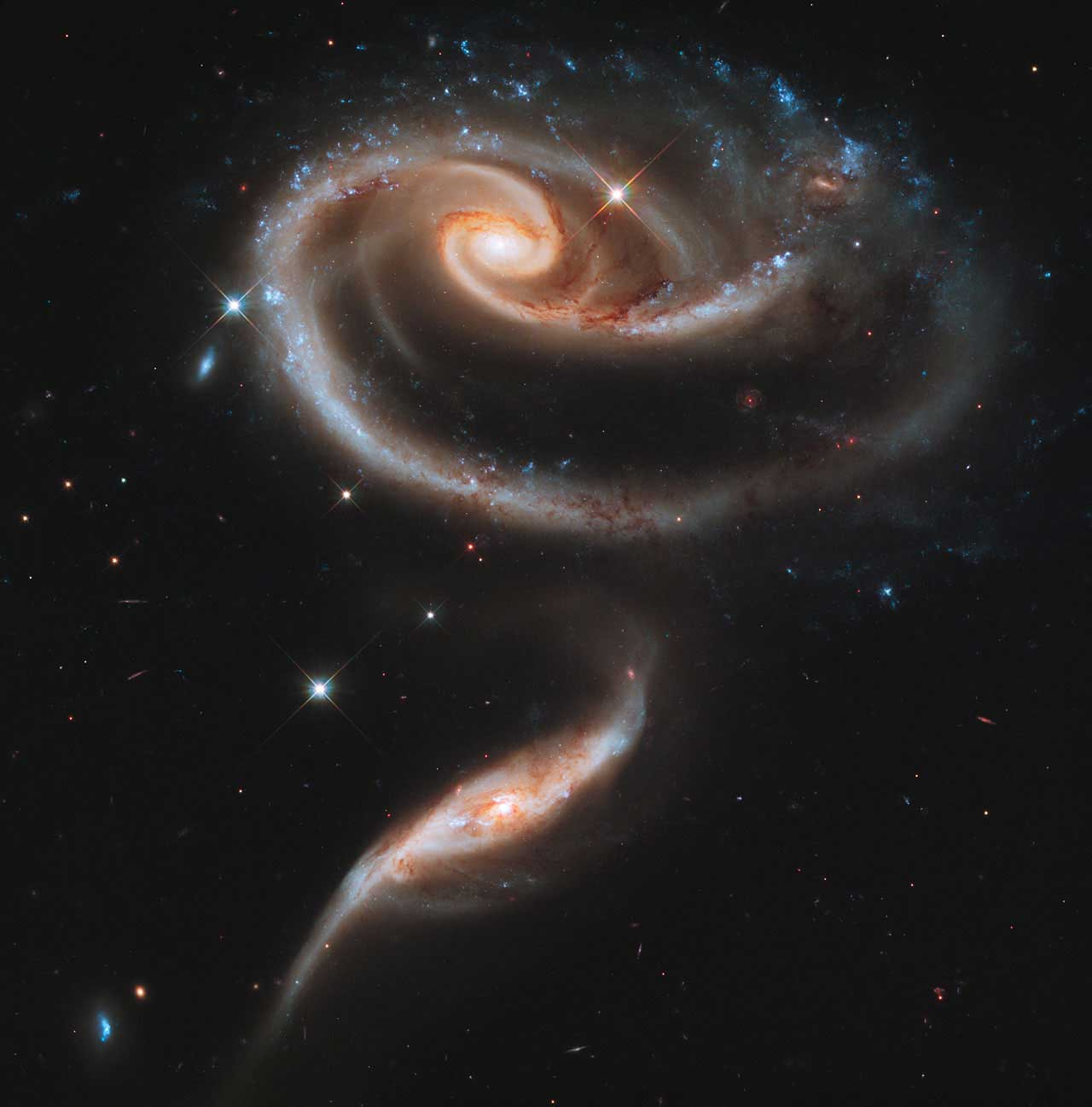 Interacting Galaxies Arp 273:                                                              A pair of interacting galaxies called Arp 273.  The distorted shape of the larger of the two galaxies shows signs of tidal interactions with the smaller of the two. It is thought that the smaller galaxy has actually passed through the larger one.                                                              Image released on April 20, 2011