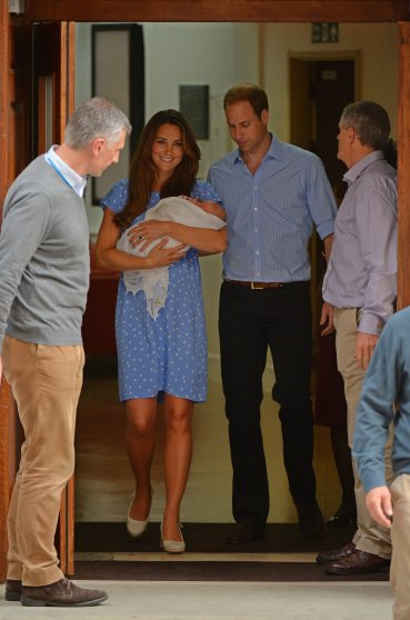 Prince William and Catherine, Duchess of Cambridge show their new-born baby boy to the world's media, leaving the Lindo Wing of St Mary's Hospital in London on July 23, 2013. The baby was born on Monday afternoon weighing eight pounds six ounces (3.8 kilogrammes). The baby, titled His Royal Highness, Prince (name) of Cambridge, is directly in line to inherit the throne after Charles, Queen Elizabeth II's eldest son and heir, and his eldest son William. AFP PHOTO / LEON NEAL (Photo credit should read LEON NEAL/AFP/Getty Images)