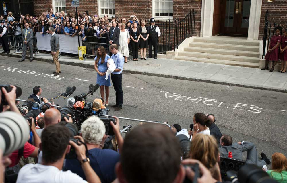 July 23, 2013 - London, Great Britain - National News and Pictures..Date: 23/07/13..PH: Hannah McKay..Pictured: Prince William, Kate and baby..Caption: Prince William and Kate leave the Lindo Wing of St Mary's hospital in Paddington today with their baby boy, the future king and show him to the waiting world. (Credit Image: © National News/ZUMAPRESS.com)